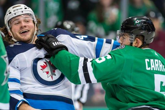 Jan. 19: Winnipeg Jets' Brendan Lemieux vs. Dallas Stars' Connor Carrick.