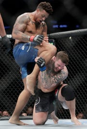 Greg Hardy knees Allen Crowder in the head during the second round of their bout.
