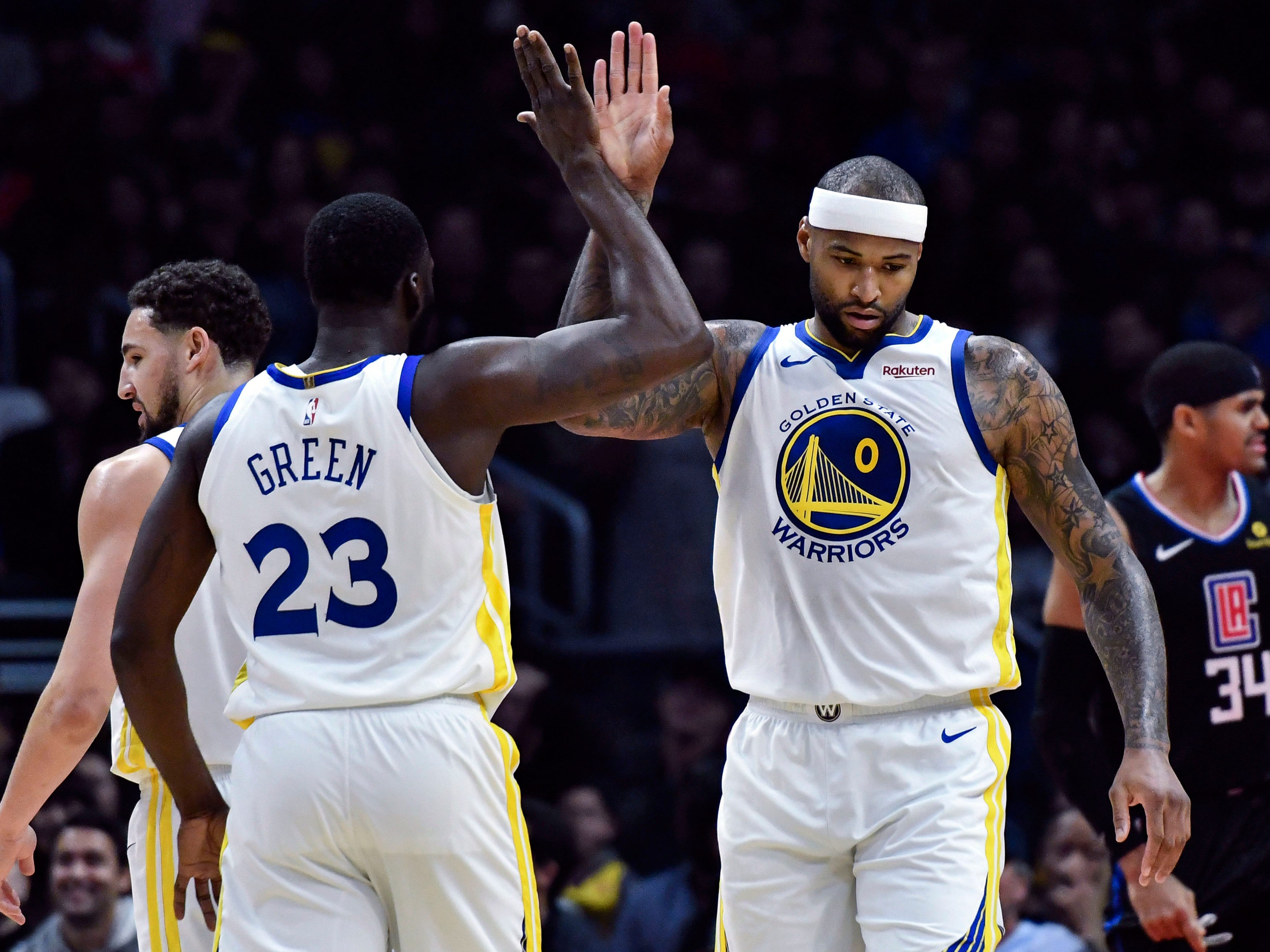 Jan. 18: Warriors center DeMarcus Cousins (0) celebrates a bucket with Draymond Green (23) during the first half against the Clippers in Los Angeles. Cousins made his long-awaited season debut for Golden State after recovering from a torn Achilles.