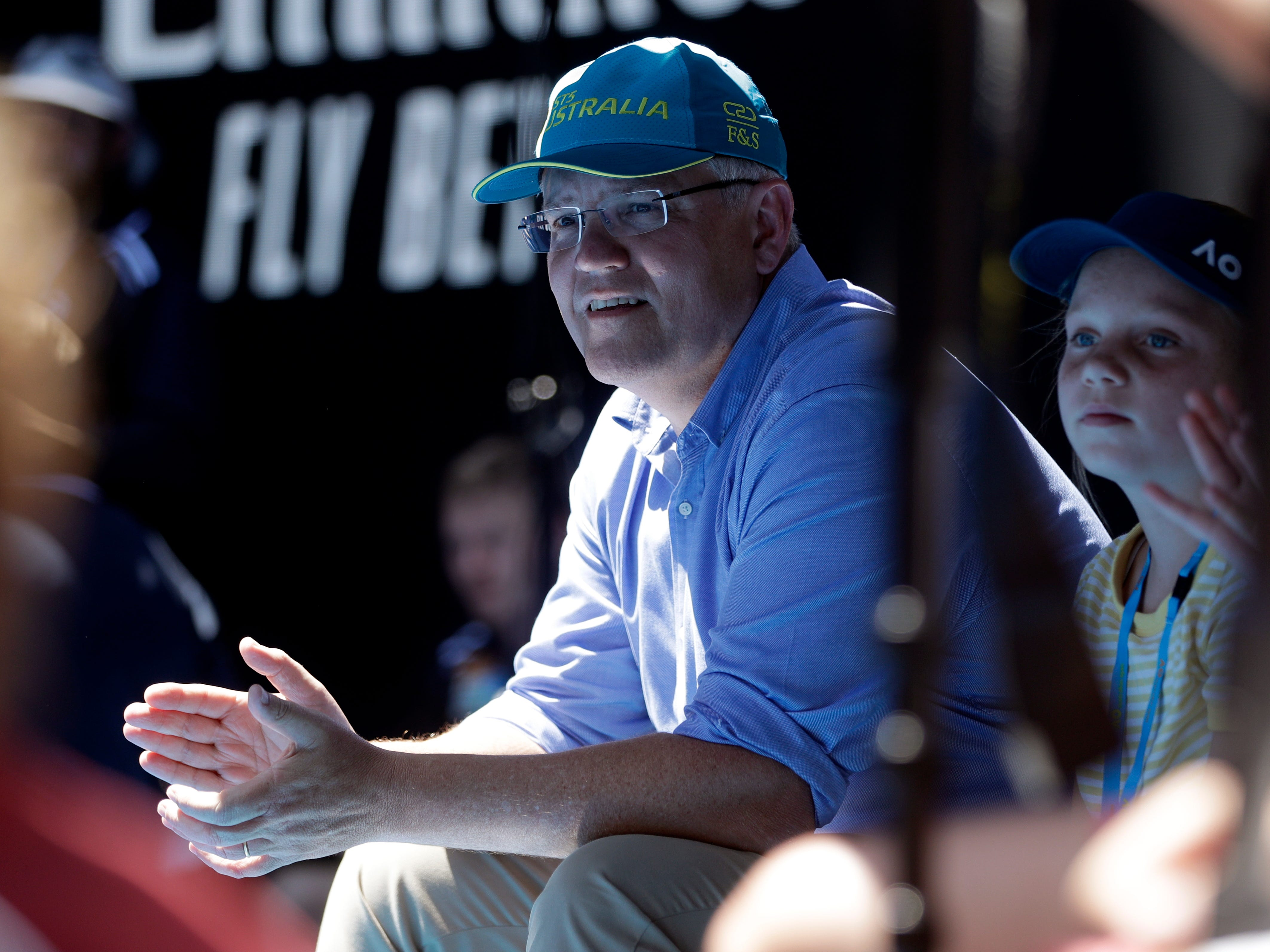 Australian Prime Minister Scott Morrison watches the fourth round match between Australia's Ashleigh Barty and Russia's Maria Sharapova.