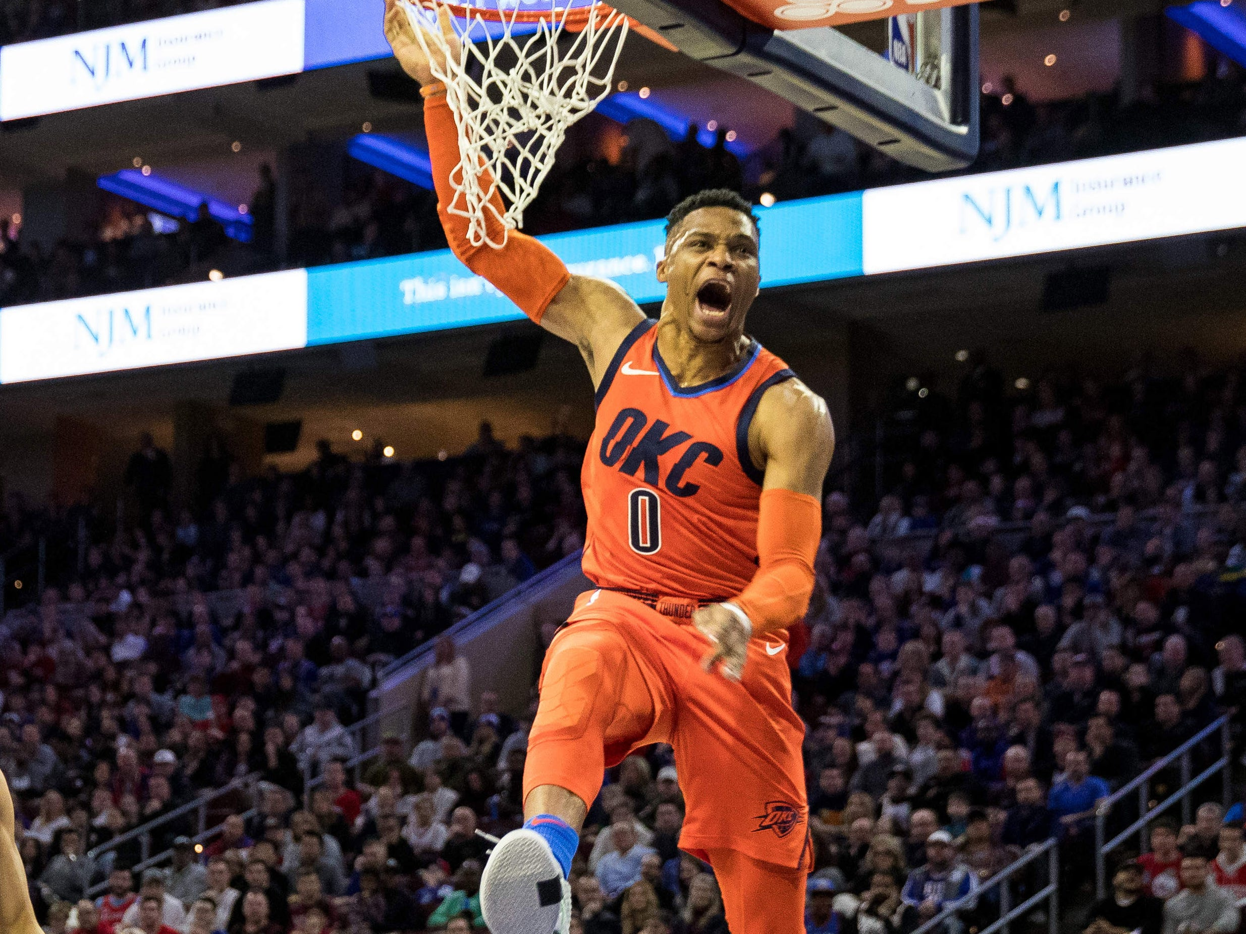 Jan. 19: Thunder guard Russell Westbrook finishes the ferocious one-handed flush during the first half against the 76ers in Philadelphia.