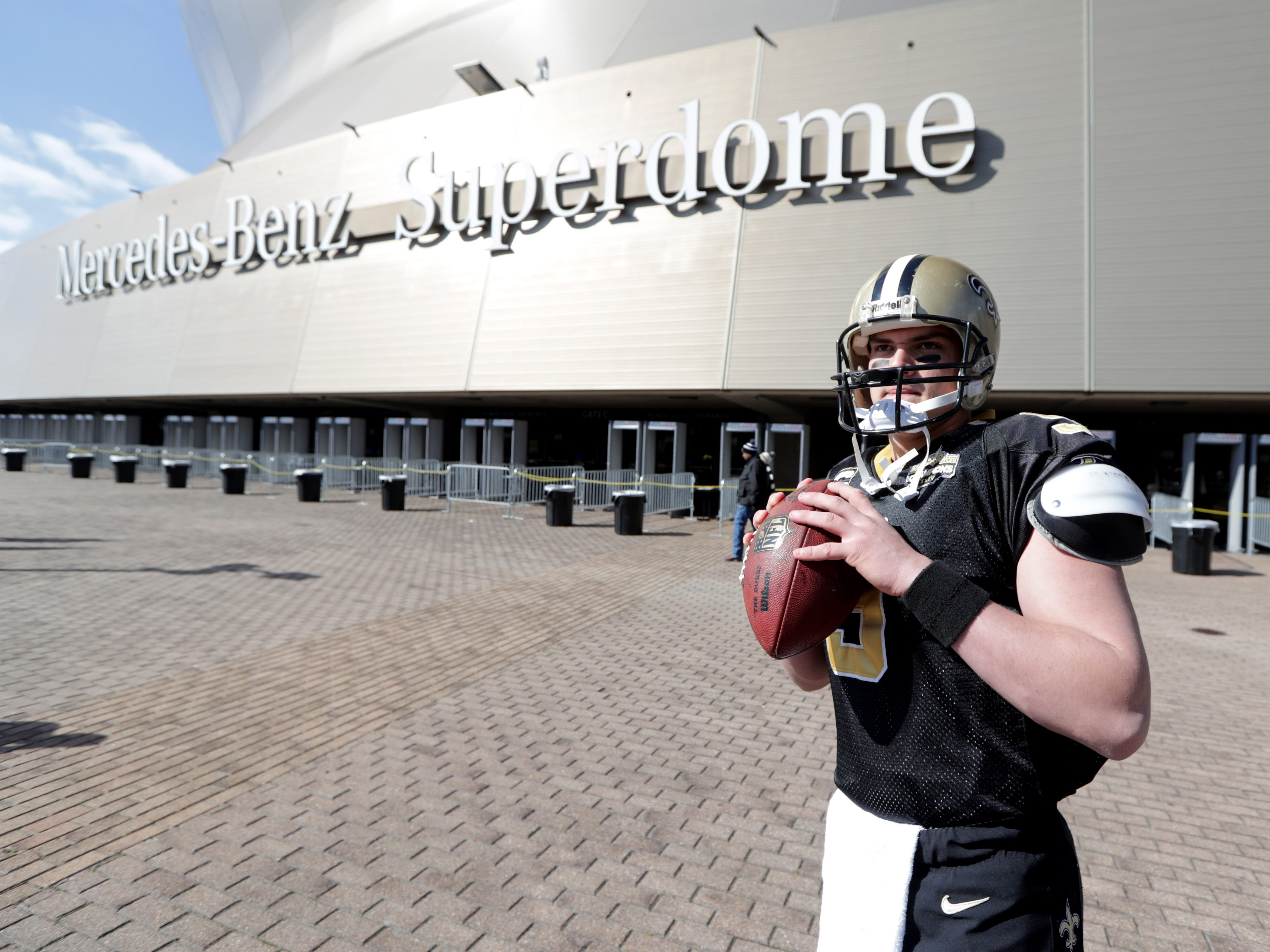 New Orleans Saints fan Felix Joseph of Abbeville, La., poses while dressed as Saints quarterback Drew Brees outside the Mercedes-Benz Superdome before the NFC Championship game between the Saints and the Los Angeles Rams.
