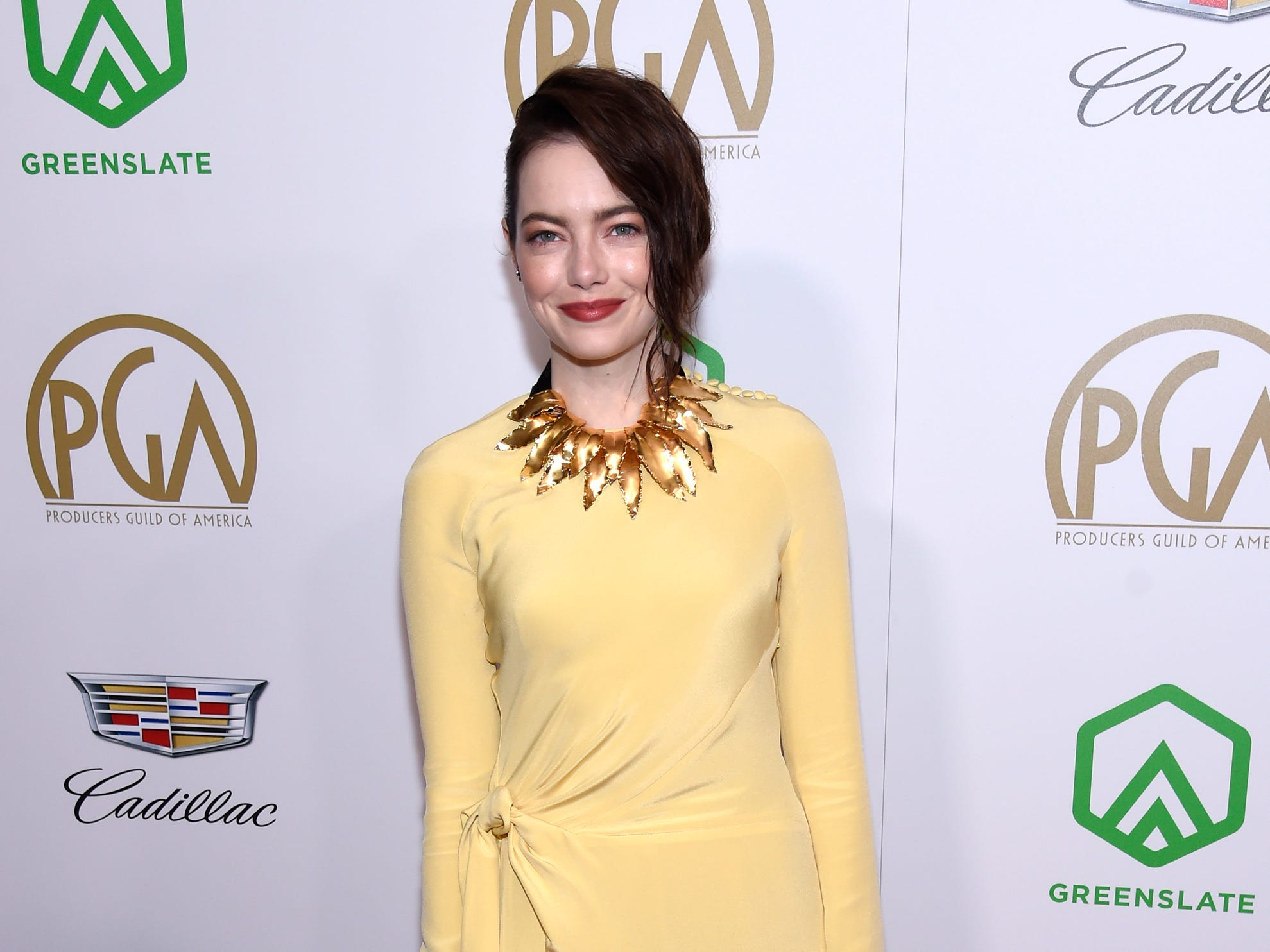 Emma Stone arrives at the Producers Guild Awards on Saturday, Jan. 19, 2019, at the Beverly Hilton Hotel in Beverly Hills, Calif. (Photo by Chris Pizzello/Invision/AP) ORG XMIT: CAPM129