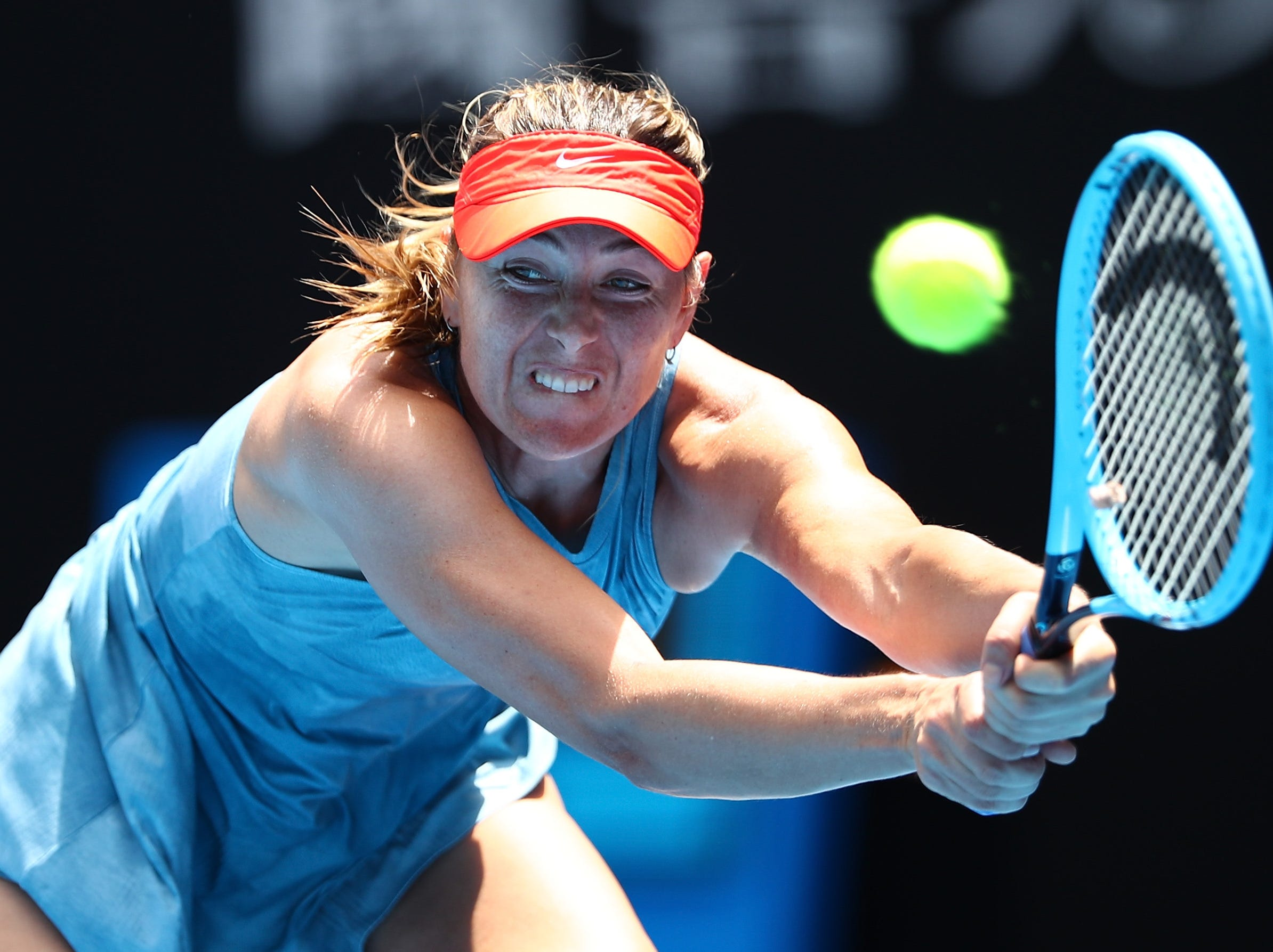 Maria Sharapova of Russia plays a backhand in her fourth-round match against Ashleigh Barty of Australia.