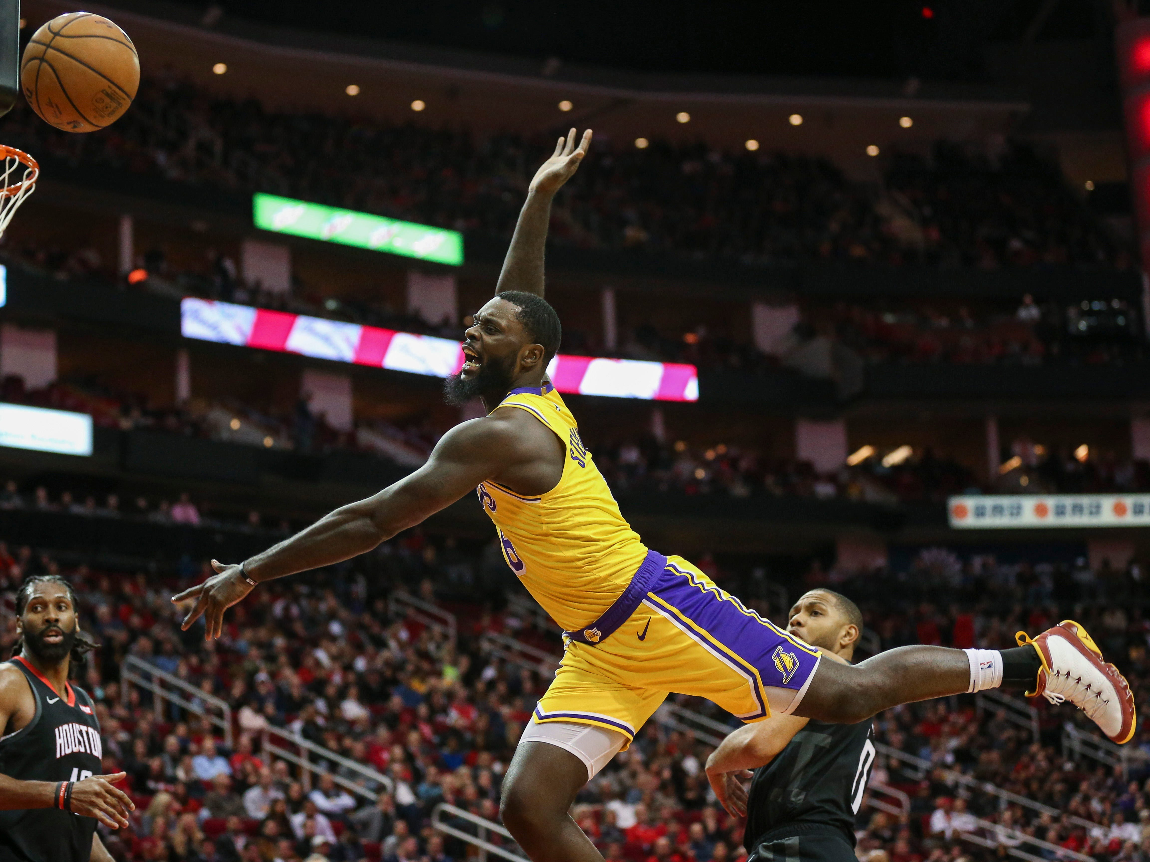 Jan. 19: Lakers guard Lance Stephenson loses control of the ball on a wild drive to the basket during the fourth quarter against the Rockets in Houston.