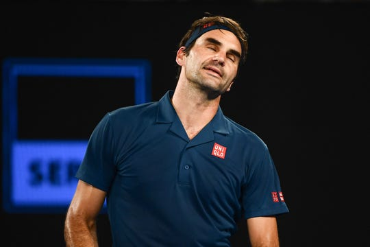 Switzerland's Roger Federer reacts after a point against Greece's Stefanos Tsitsipas during their match at the Australian Open.
