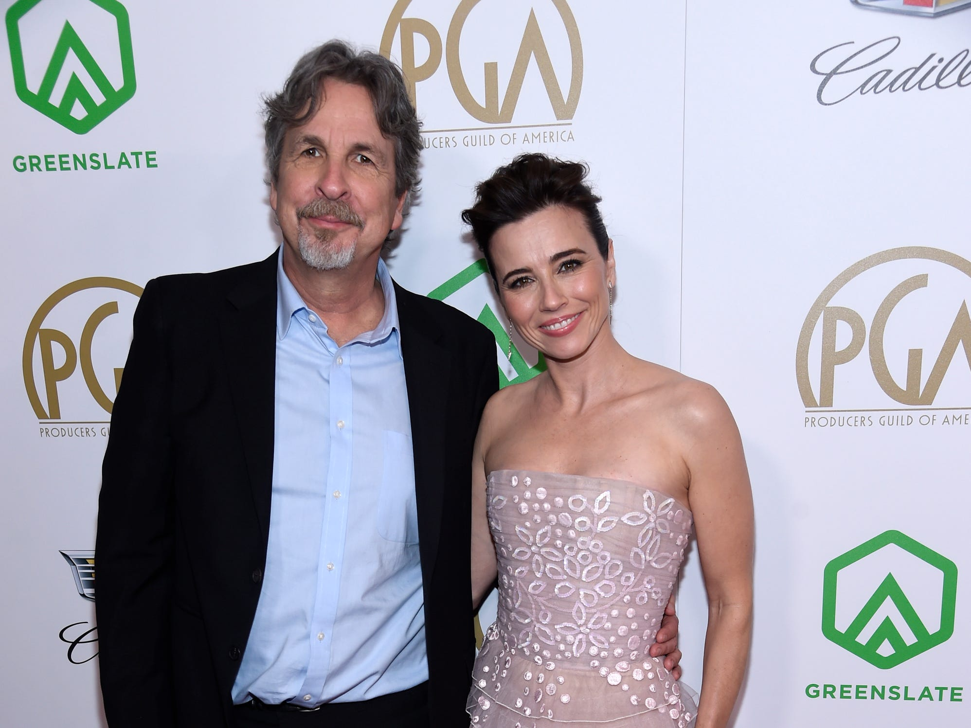 Peter Farrelly, left, and Linda Cardellini arrive at the Producers Guild Awards on Saturday, Jan. 19, 2019, at the Beverly Hilton Hotel in Beverly Hills, Calif. (Photo by Chris Pizzello/Invision/AP) ORG XMIT: CAPM125