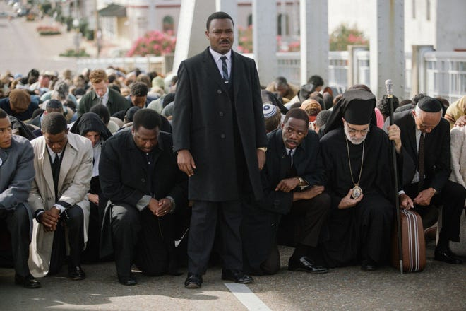 Center from left, Wendell Pierce plays Rev. Hosea Williams, David Oyelowo plays Martin Luther King, Jr., and Colman Domingo plays Ralph Abernathy in the movie Selma.