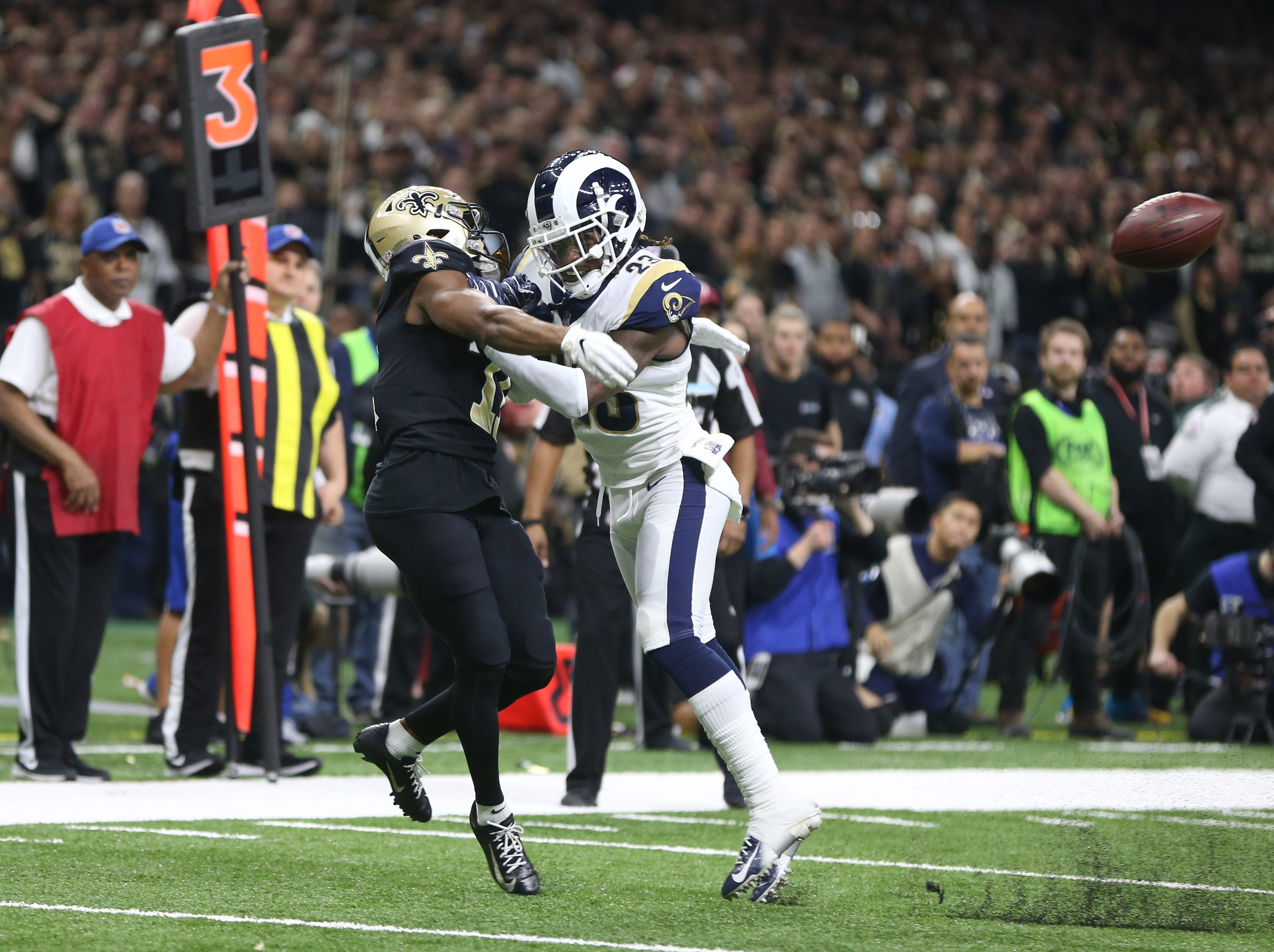 Los Angeles Rams defensive back Nickell Robey-Coleman (23) breaks up a pass intended or New Orleans Saints wide receiver Tommylee Lewis (11) during the fourth quarter.