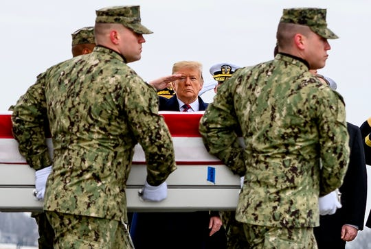 President Donald Trump salutes the return of fallen troops in Dover, Delaware, on Jan. 19, 2019.