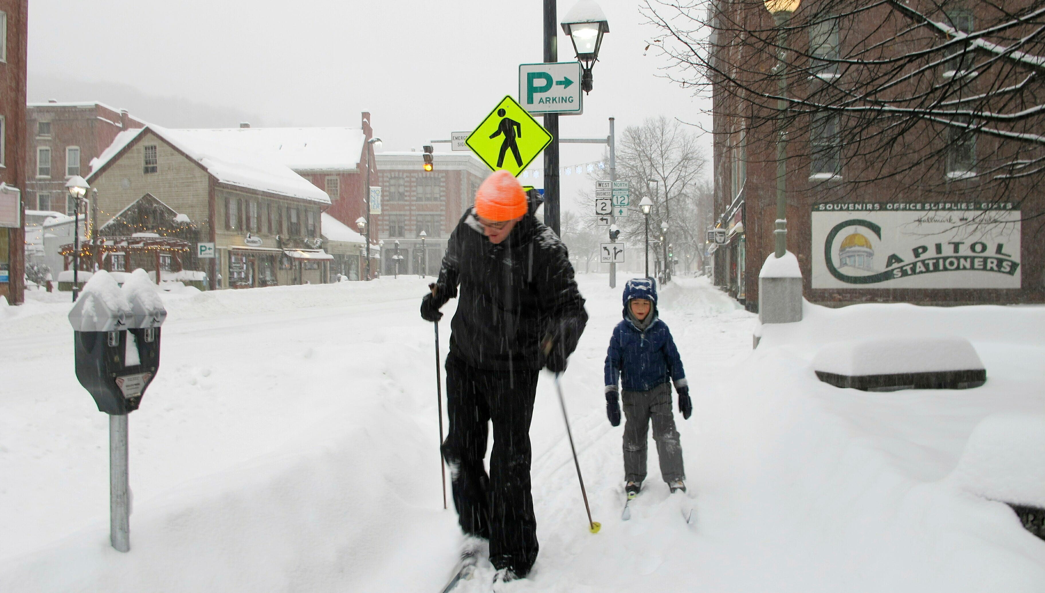 Nicholas Nicolet and his son Rocco cross-country ski on Sunday, Jan. 20, 2019, in Montpelier, Vt.
