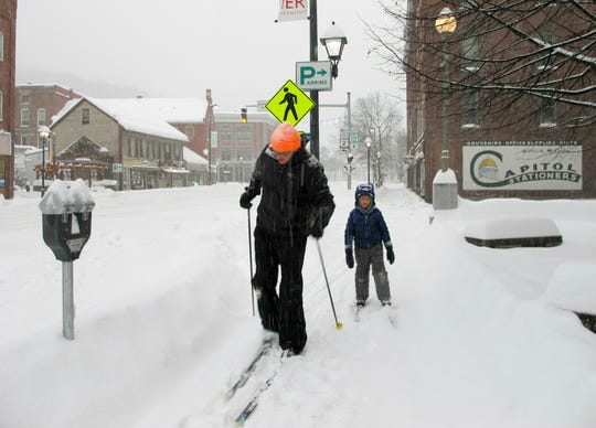Nicholas Nicolet and his son Rocco cross-country ski on Jan. 20, 2019, in Montpelier, Vt.