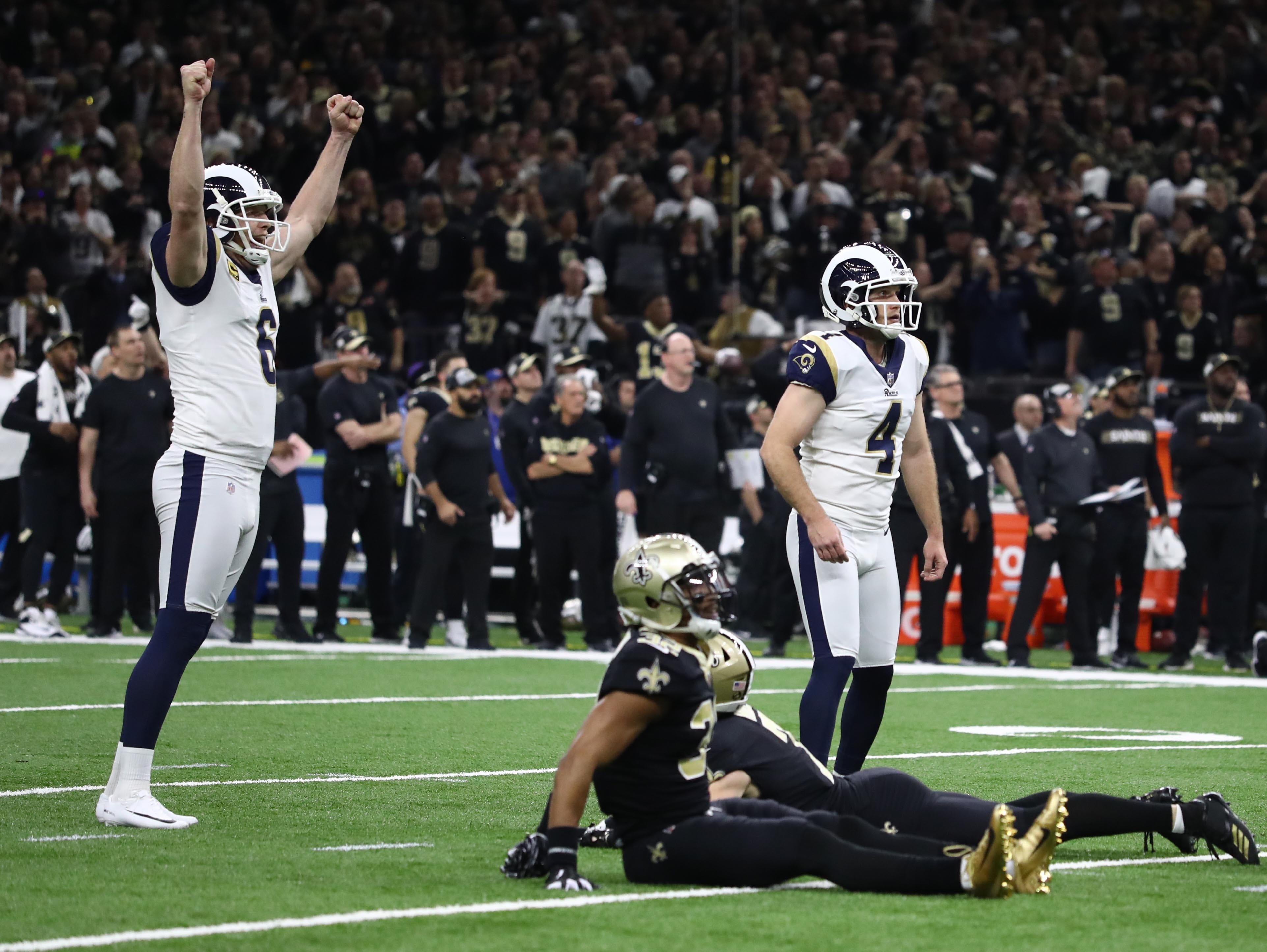 Los Angeles Rams kicker Greg Zuerlein (4) celebrates with punter Johnny Hekker (6) after kicking the tying field goal against the New Orleans Saints during the fourth quarter.