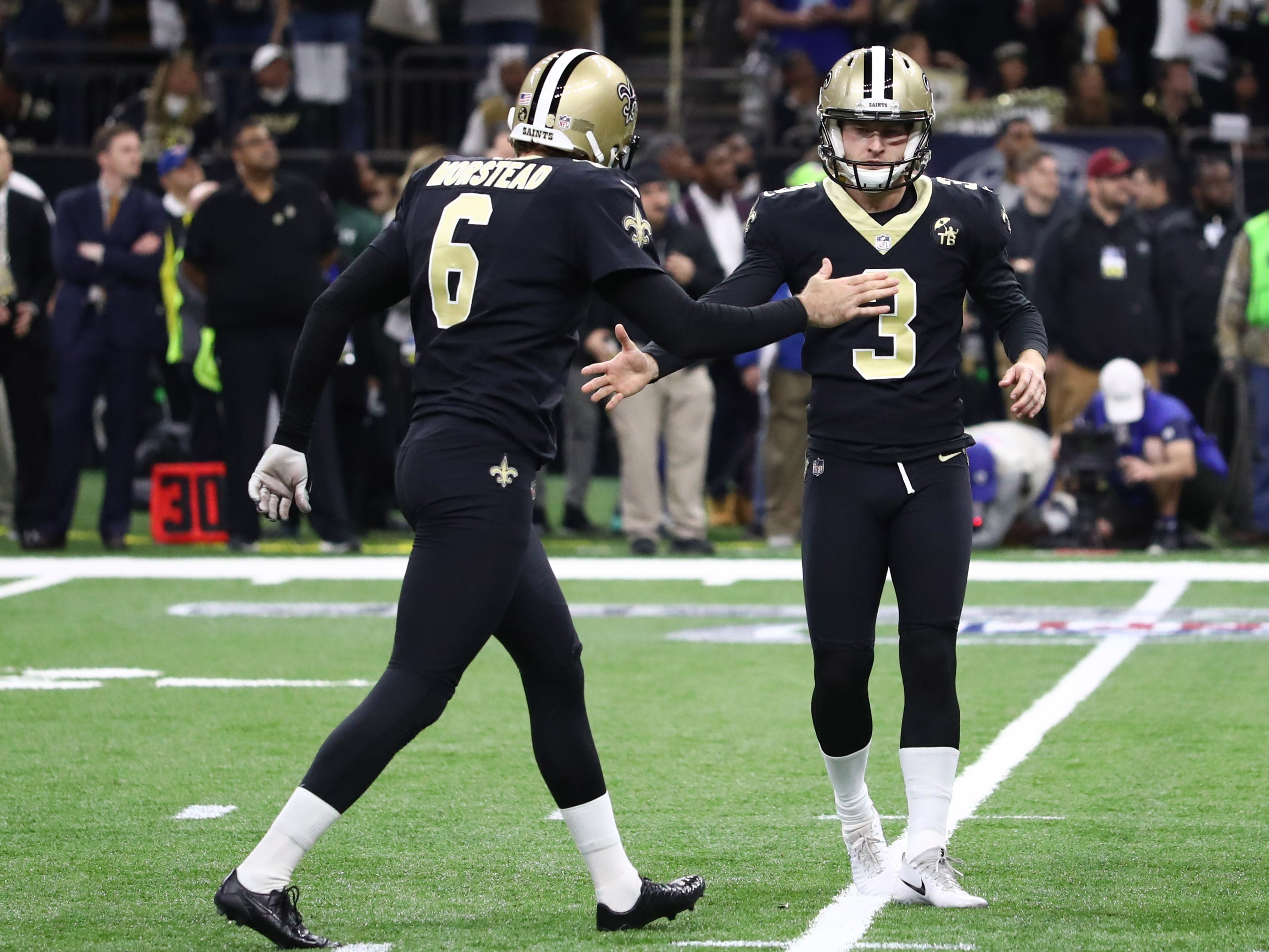 New Orleans Saints kicker Wil Lutz (3) celebrates with punter Thomas Morstead (6) after a field goal against the Los Angeles Rams  during the first quarter in the NFC Championship game at Mercedes-Benz Superdome.
