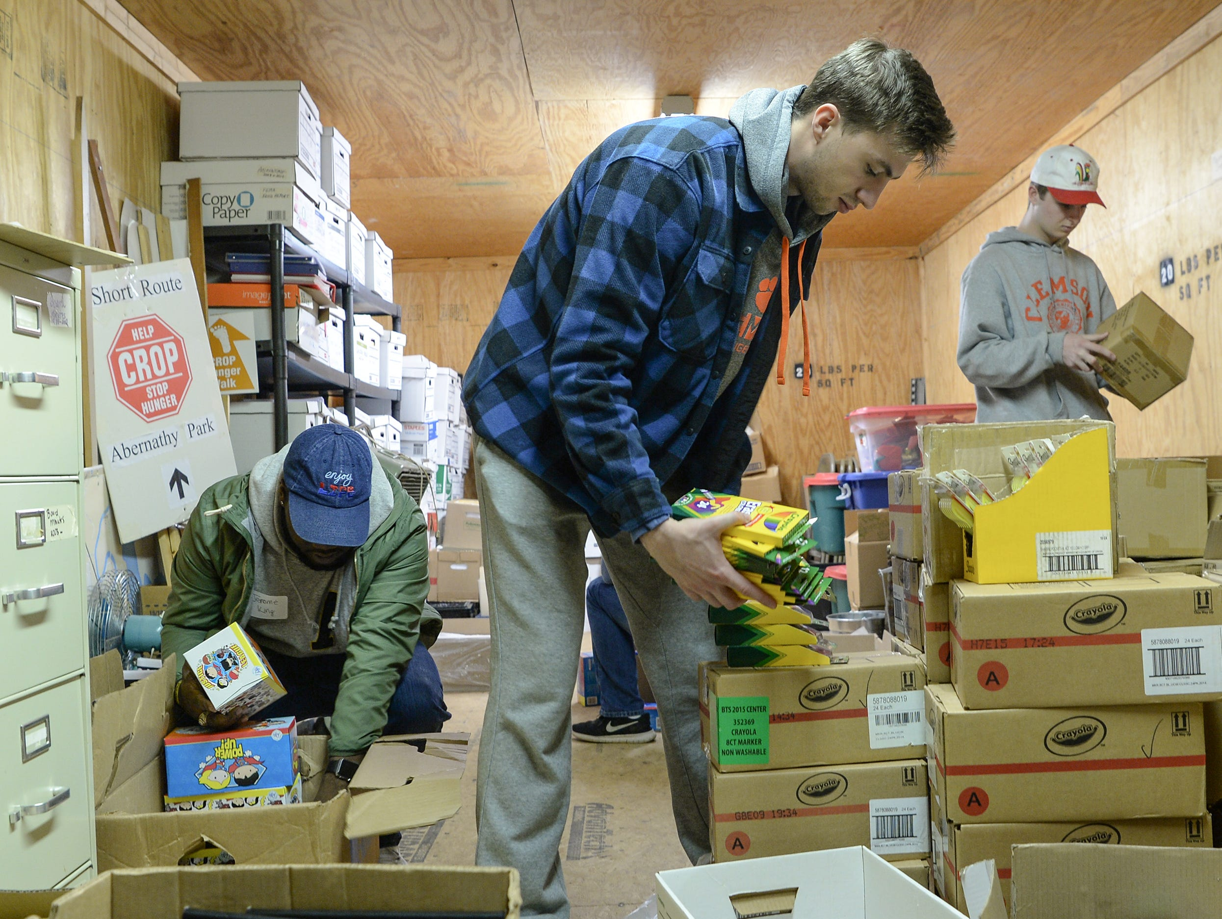 Jerome King, left, of Alpha Phi Alpha fraternity joins Phi Gamma Delta fraternity volunteers Dayne Hughes, middle organize school supplies at Clemson Community Care, during the Clemson University Martin Luther King, Jr. Service Day in Clemson January 21, 2019.