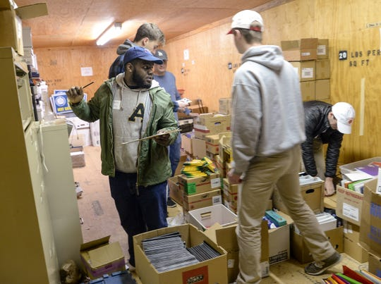 Jerome King, left, of Alpha Phi Alpha fraternity joins Phi Gamma Delta fraternity volunteers organizing school supplies at Clemson Community Care, during the Clemson University Martin Luther King, Jr. Service Day in Clemson January 21, 2019.