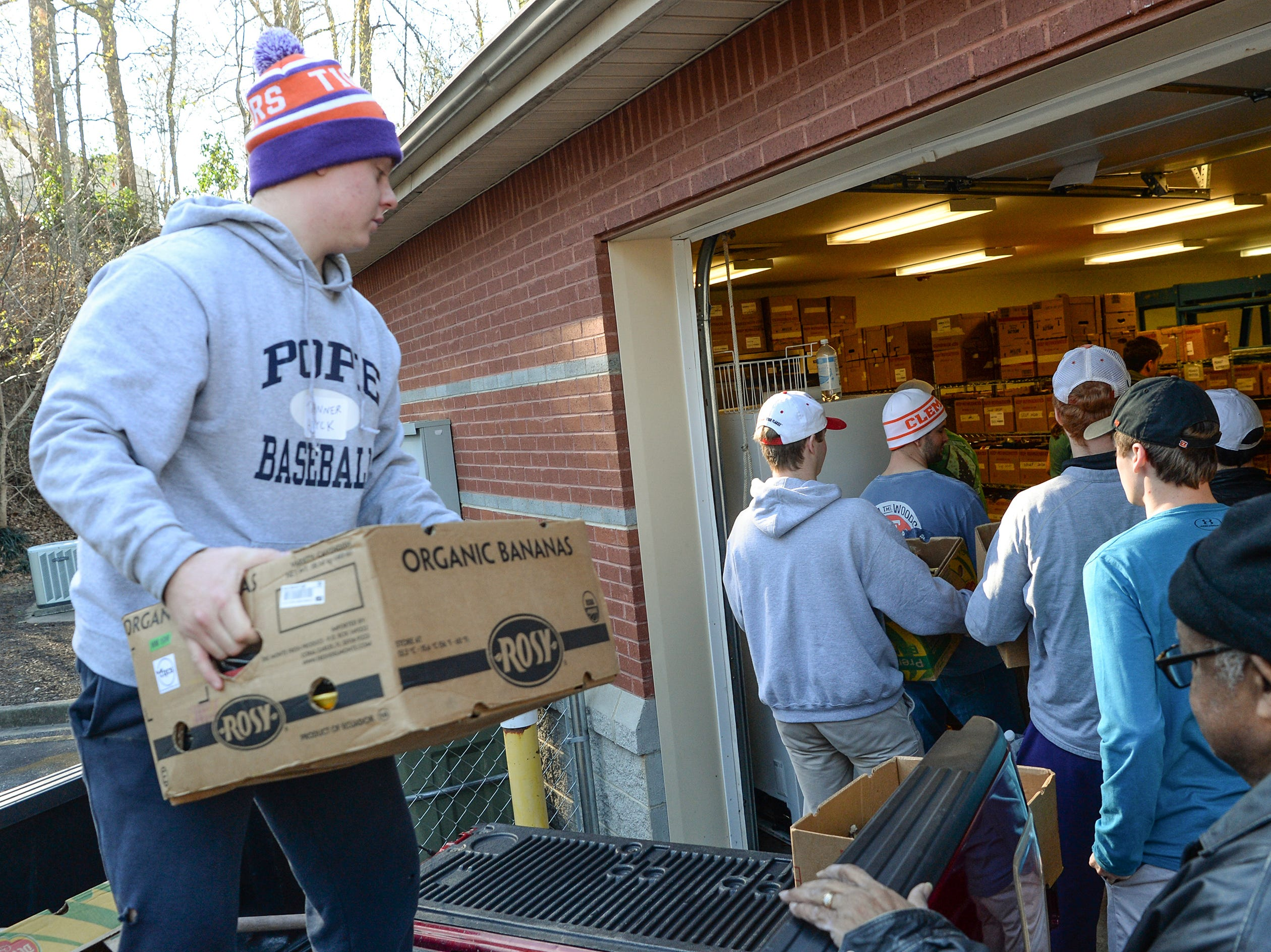 Tanner Hurck, left, of Phi Gamma Delta fraternity helps bring in donated food supplies at Clemson Community Care, during the Clemson University Martin Luther King, Jr. Service Day in Clemson January 21, 2019.