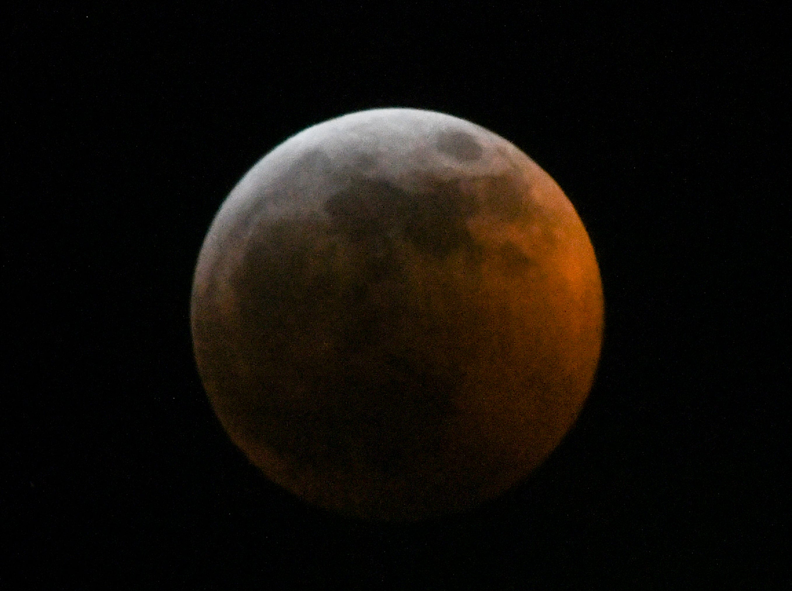 The Super blood wolf moon total lunar eclipse, at 11:45 p.m. (EST) January 20, 2019, shortly after when the moon edged into Earth's shadow and became darkened at 11:41 p.m., seen from Anderson, S.C.