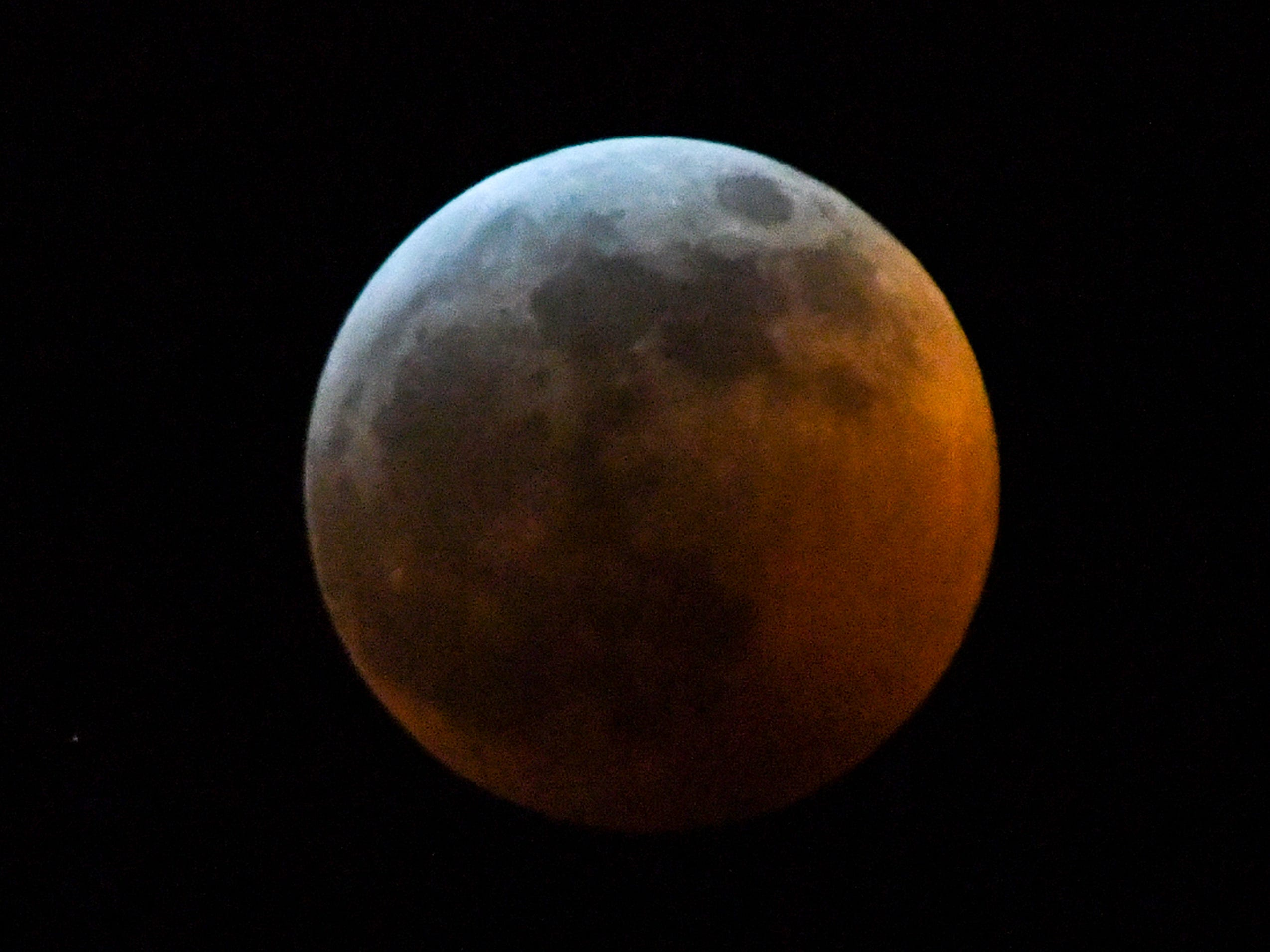 The Super blood wolf moon total lunar eclipse, at 11:51 p.m. (EST) January 20, 2019, shortly after when the moon edged into Earth's shadow and became darkened at 11:41 p.m., seen from Anderson, S.C.