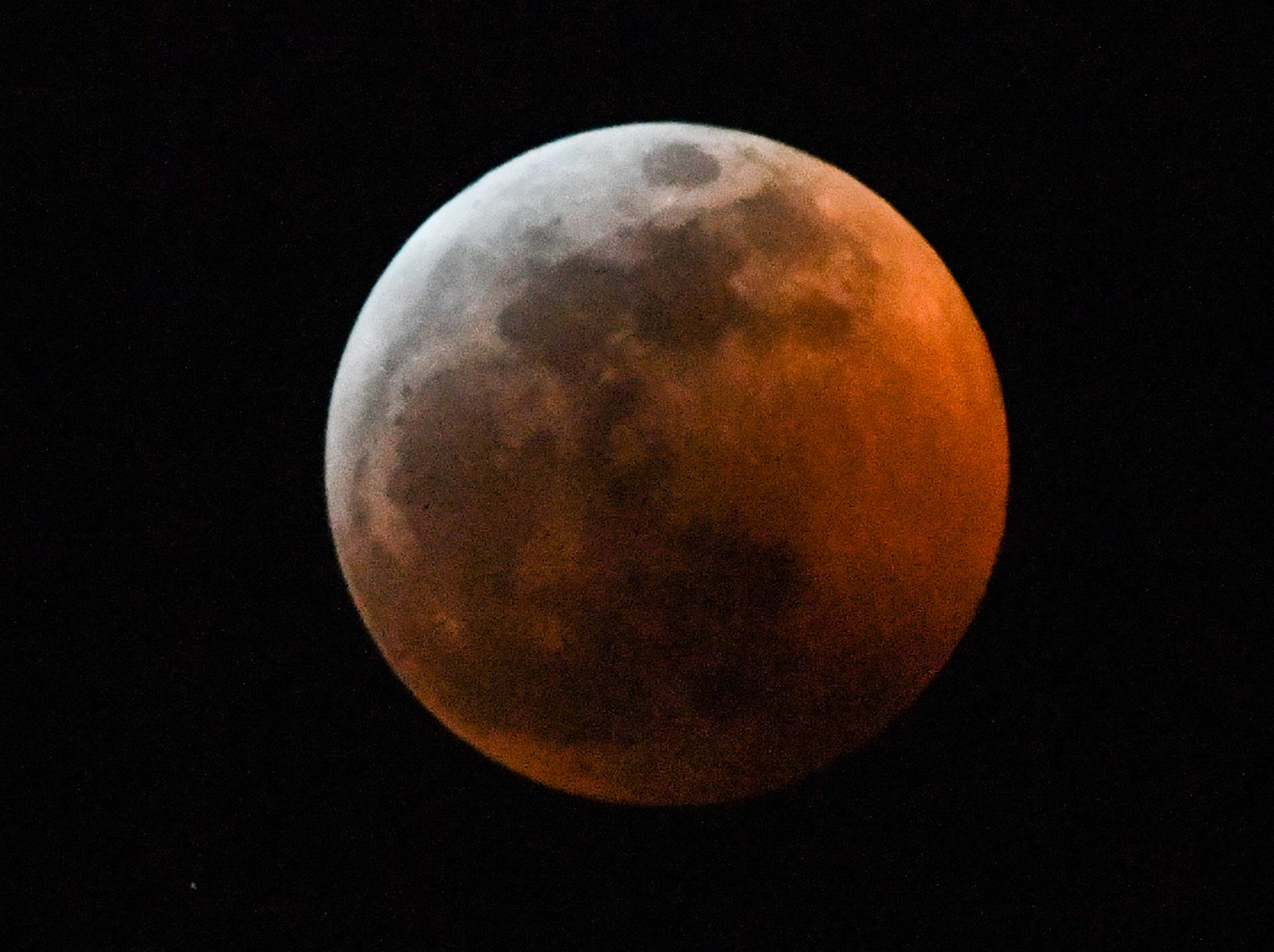 The Super blood wolf moon total lunar eclipse, at 11:49 p.m. (EST) January 20, 2019, shortly after when the moon edged into Earth's shadow and became darkened at 11:41 p.m., seen from Anderson, S.C.