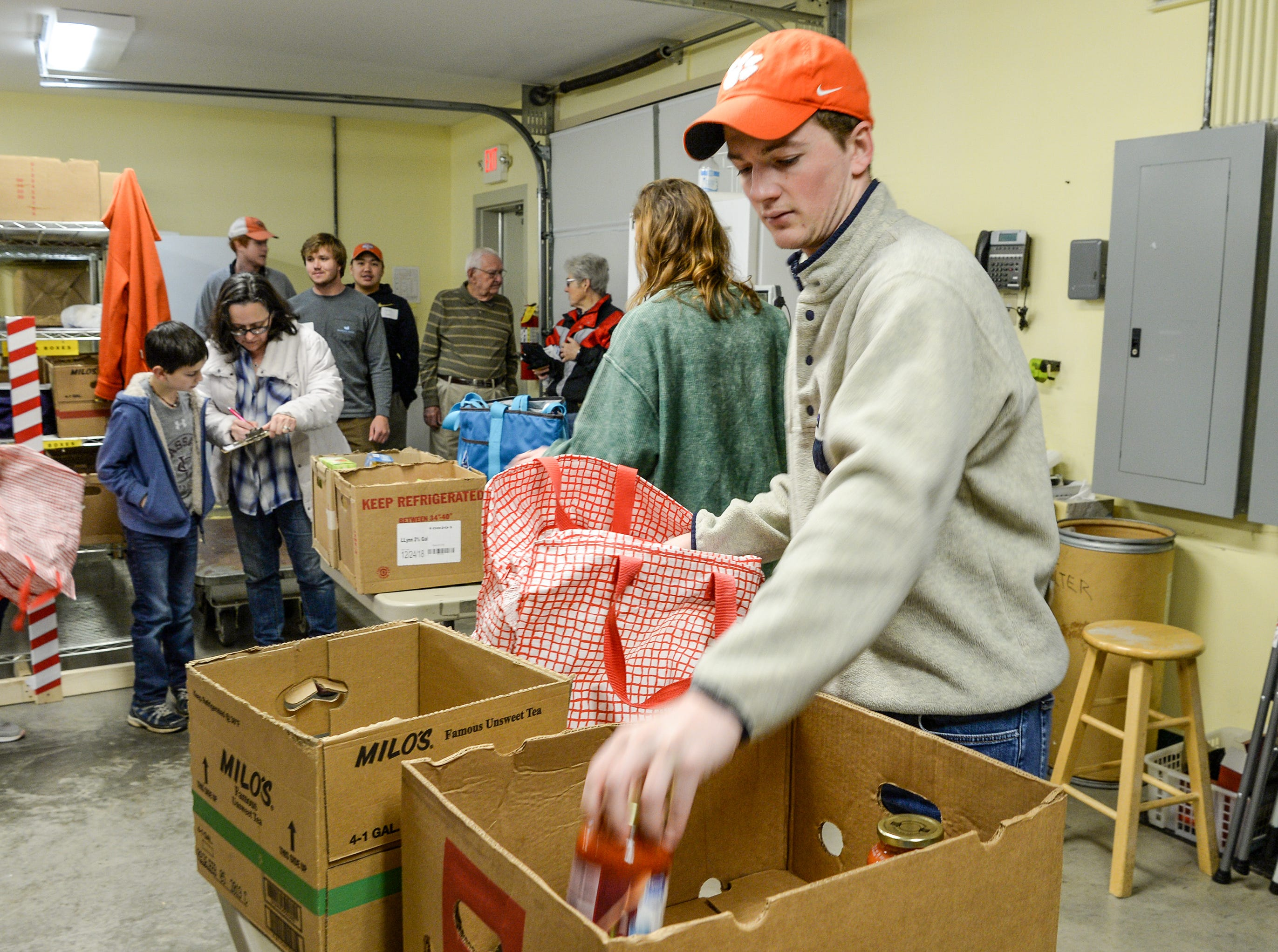 Fred O'Donnell, right, of Phi Gamma Delta fraternity helps organize donated food supplies from the Laurence family at Clemson Community Care, during the Clemson University Martin Luther King, Jr. Service Day in Clemson January 21, 2019.