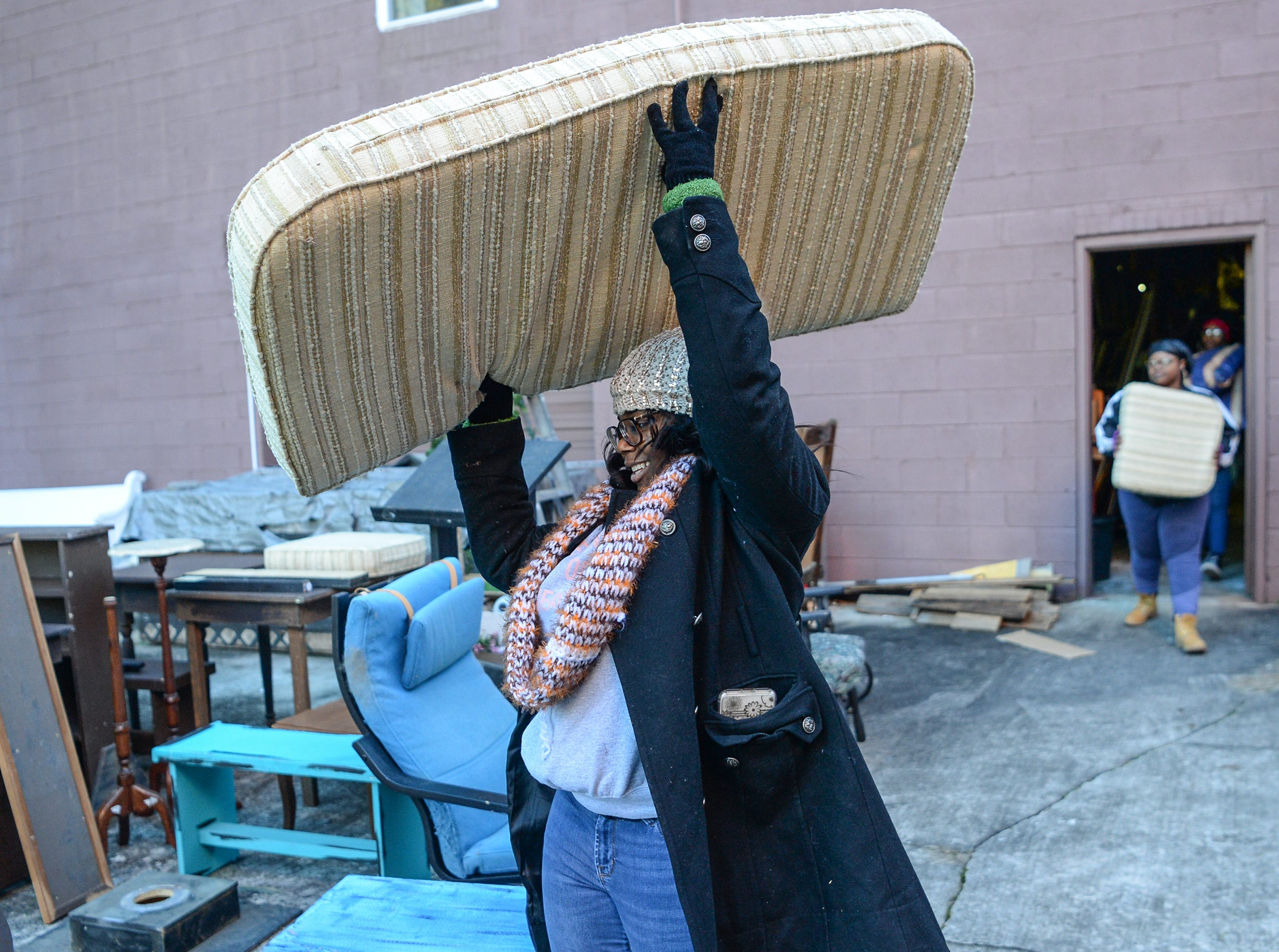 Malaysia Barr, with Clemson University Gospel Choir members, helps organize a prop and costume storage area at Clemson Little Theatre during the Clemson University Martin Luther King, Jr. Service Day in Clemson January 21, 2019.