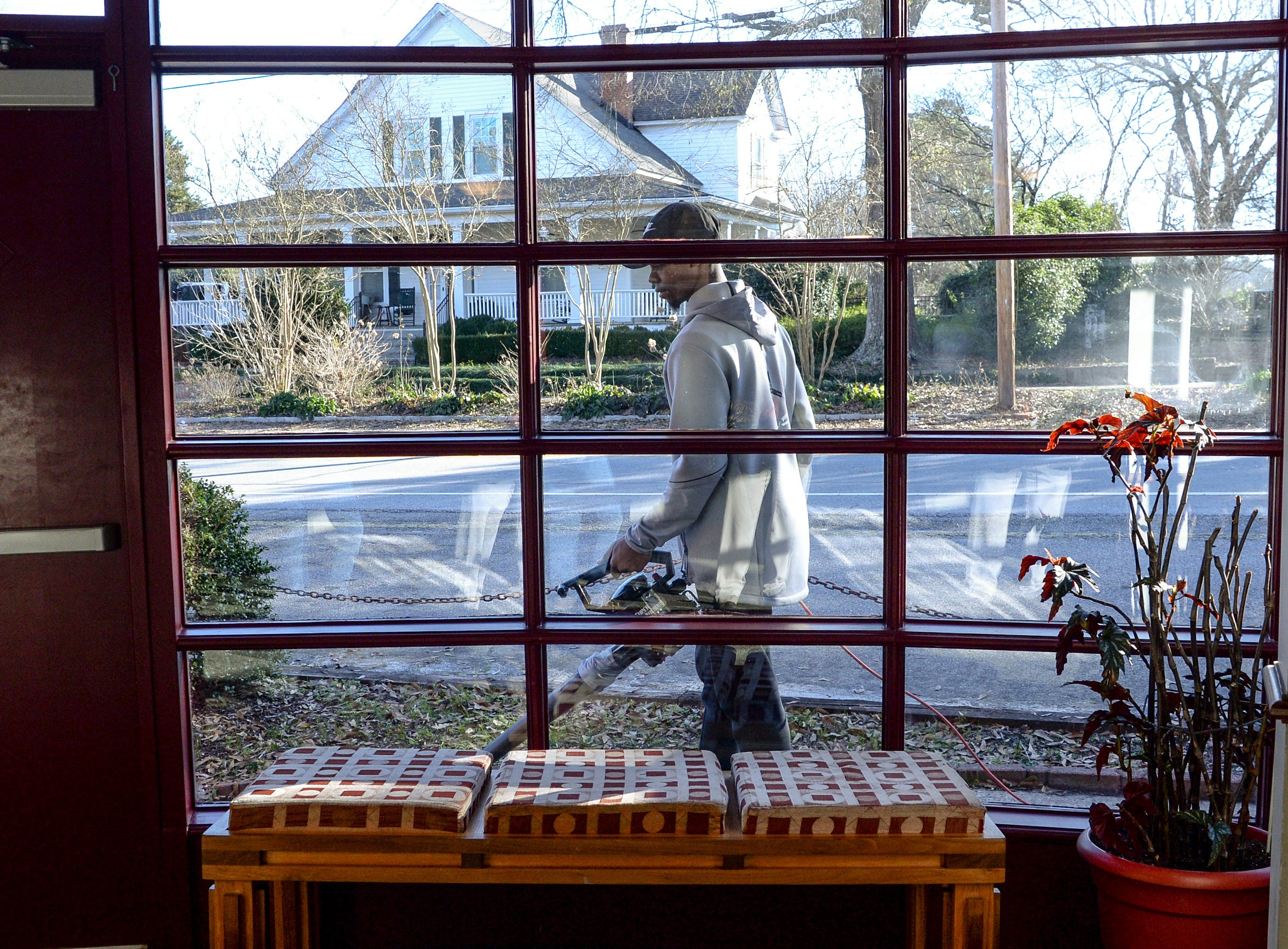 Kendal Pettway of Alpha Phi Alpha fraternity, uses a leaf blower outside Clemson Little Theatre during the Clemson University Martin Luther King, Jr. Service Day in Clemson January 21, 2019.