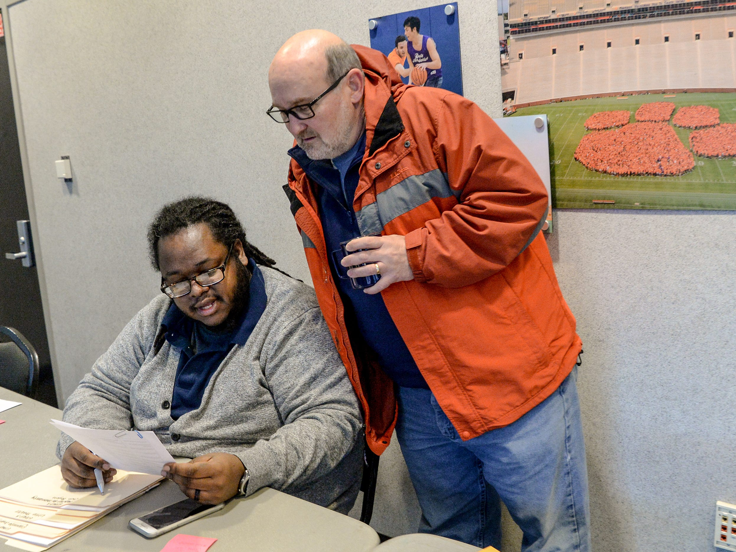 Jerad Green, left, Clemson University Associate Director for Multicultural Programs, and Chris Heavner, Clemson University Lutheran Campus Pastor, help students with assignments at the Hendrix Student Center, during the Clemson University Martin Luther King, Jr. Service Day in Clemson January 21, 2019.