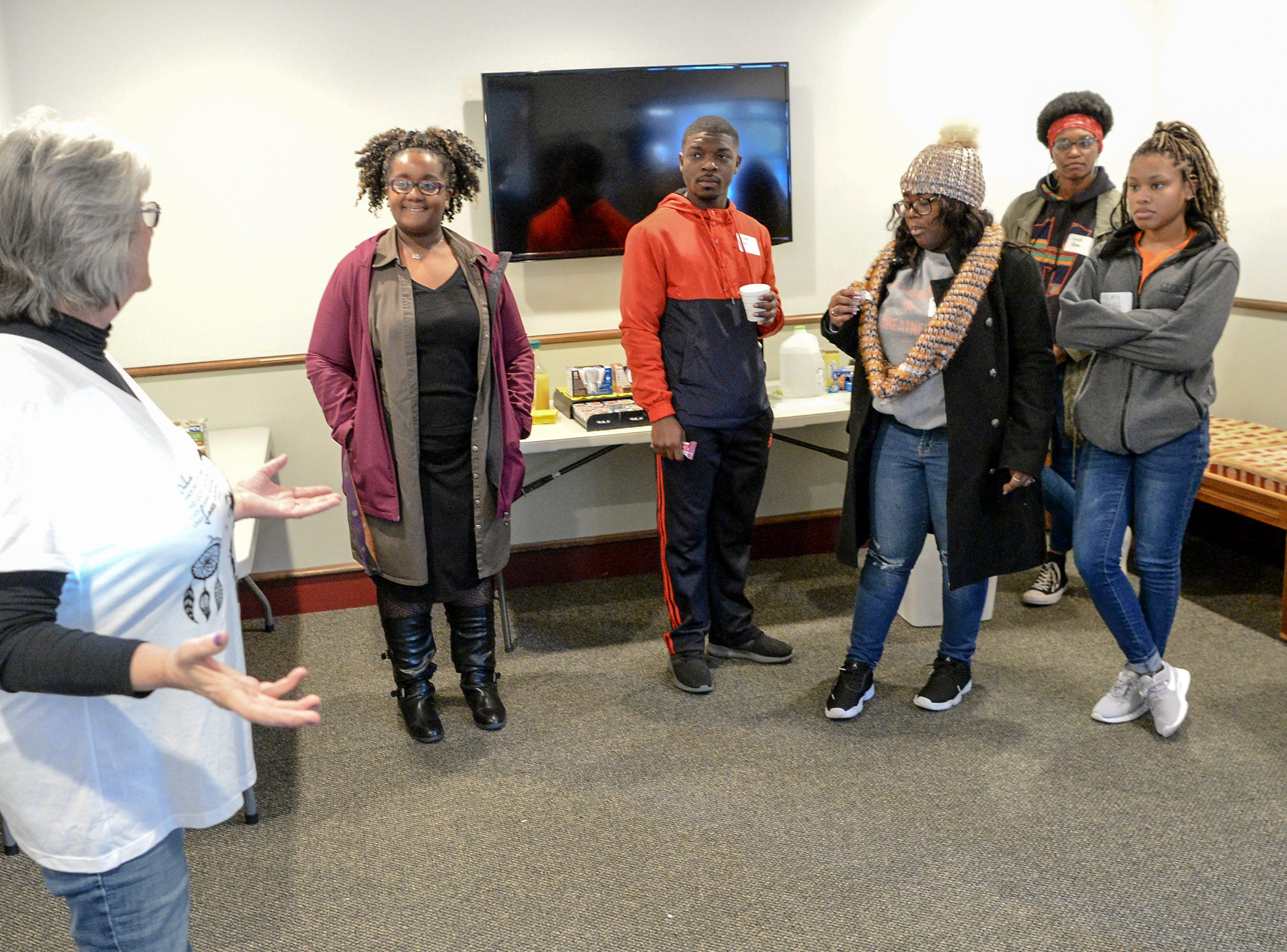 Linda Lavold, Clemson Little Theatre office manager, talks with Clemson University Gospel Choir members before they helped organize and clean during the Clemson University Martin Luther King, Jr. Service Day in Clemson January 21, 2019.