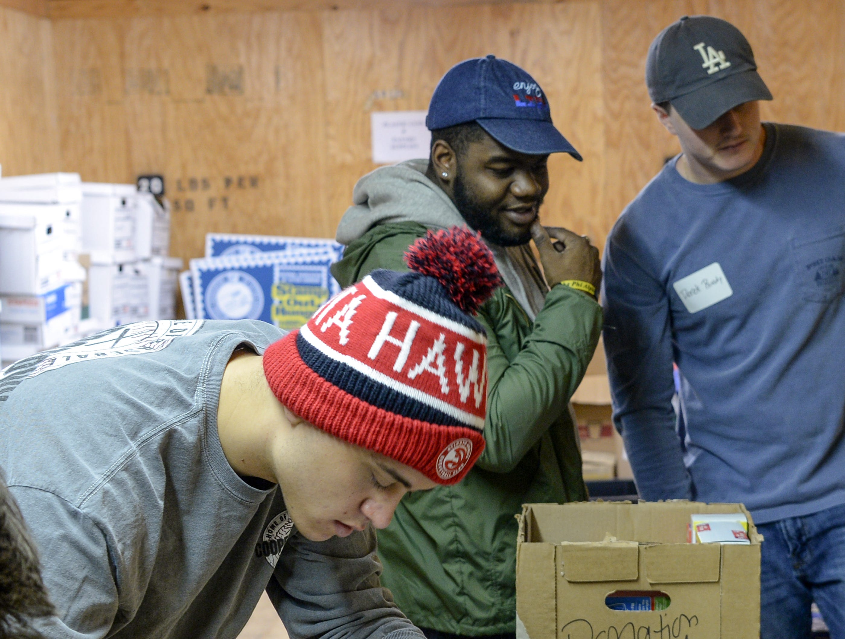 Calen Confer, left, with Phi Gamma Delta fraternity members and Jerome King, left, of Alpha Phi Alpha fraternity, and Derek Ruedy, right, organize school supplies at Clemson Community Care, during the Clemson University Martin Luther King, Jr. Service Day in Clemson January 21, 2019.