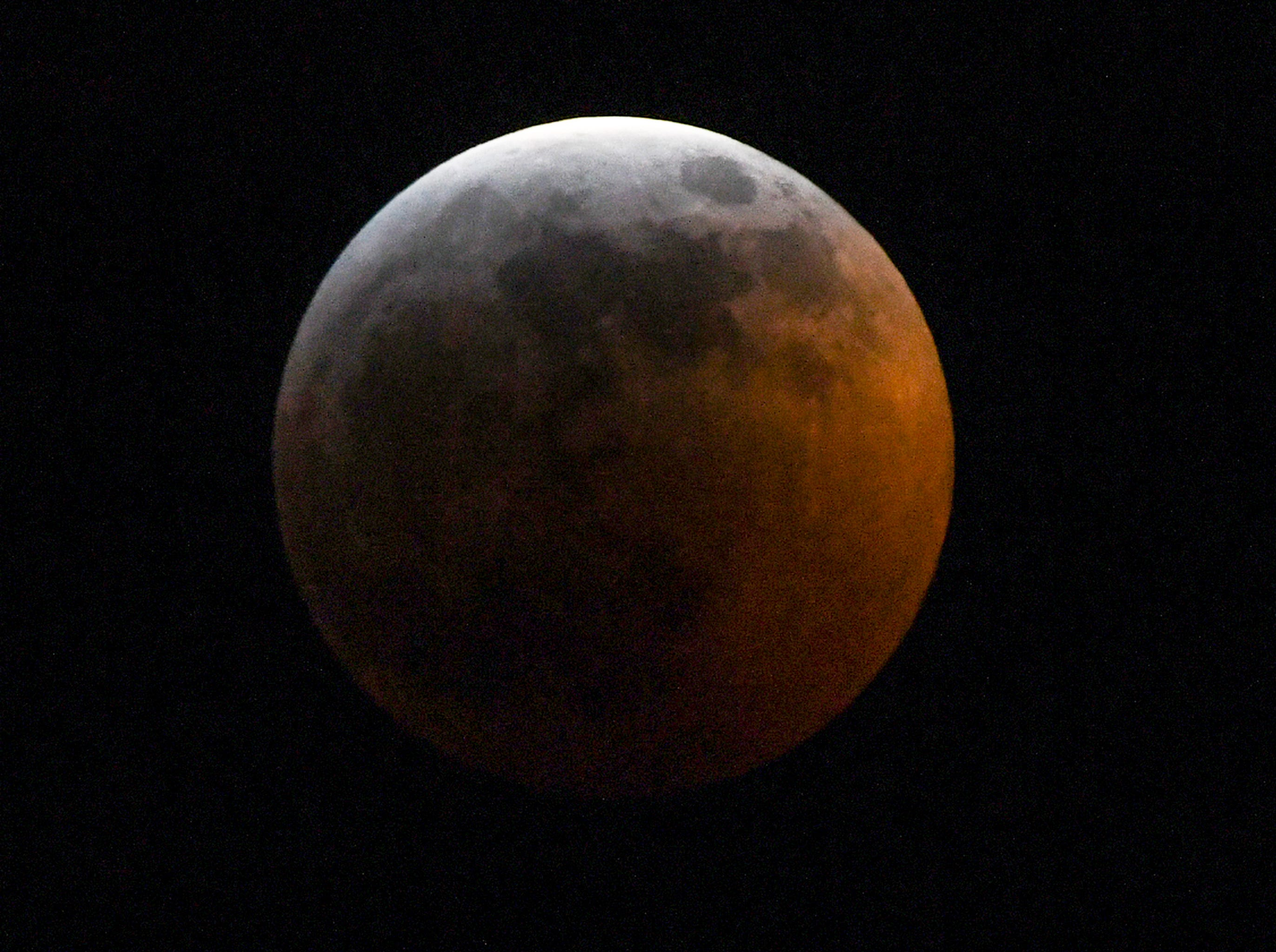 The Super blood wolf moon total lunar eclipse, at 11:38 p.m. (EST) January 20, 2019, when the moon began edging into Earth's shadow and minutes later became darkened at 11:41 p.m., seen from Anderson, S.C.