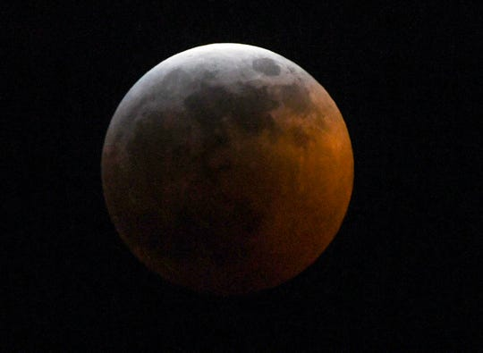 The super blood wolf moon total lunar eclipse, at 11:38 p.m. (EST) Sunday, when the moon began edging into Earth's shadow and minutes later became darkened at 11:41 p.m., seen from Anderson, South Carolina.