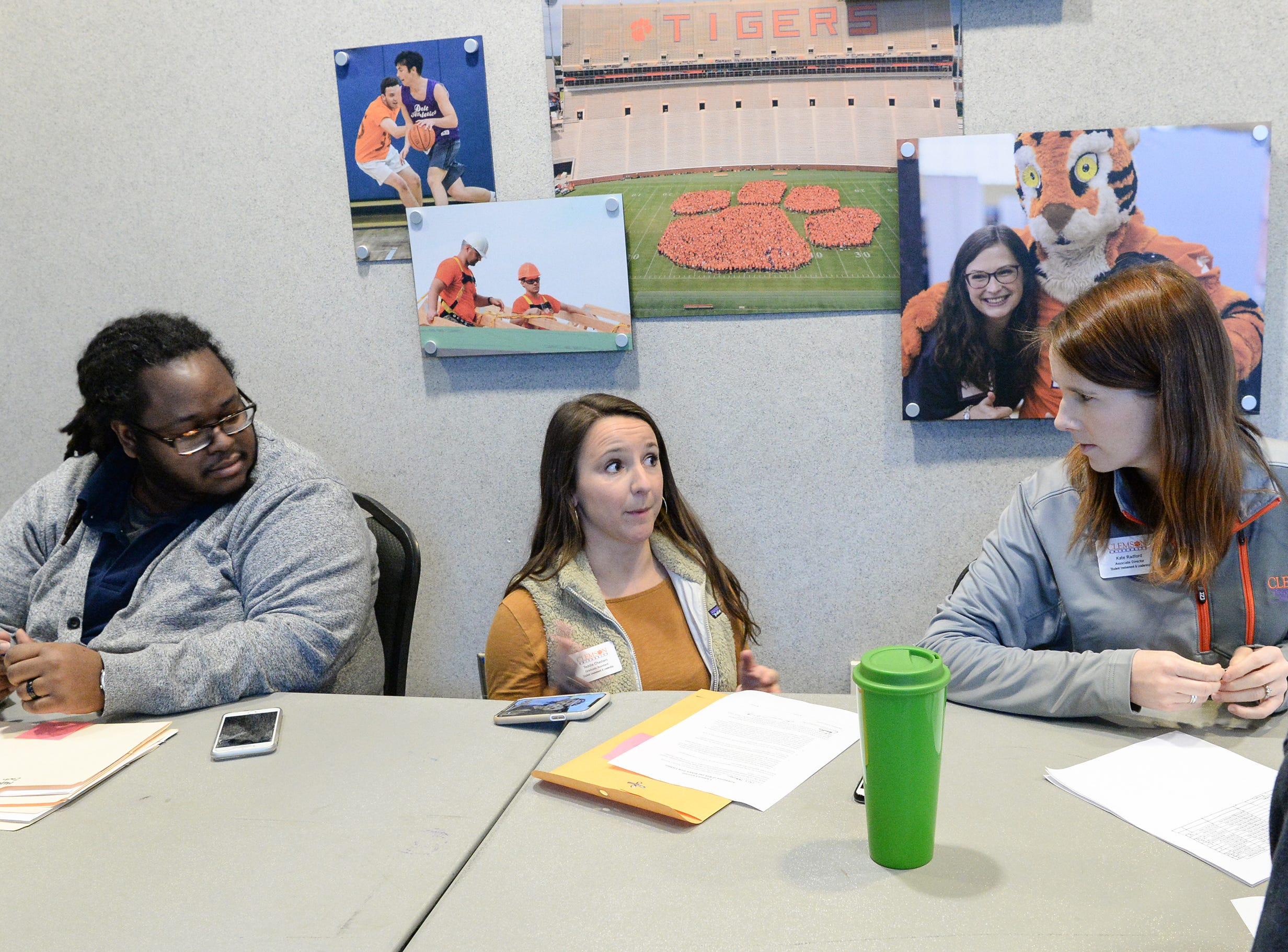 Jerad Green, left, Teddie Chastain, and Katie Radford help students with assignments at the Hendrix Student Center, during the Clemson University Martin Luther King, Jr. Service Day in Clemson January 21, 2019.