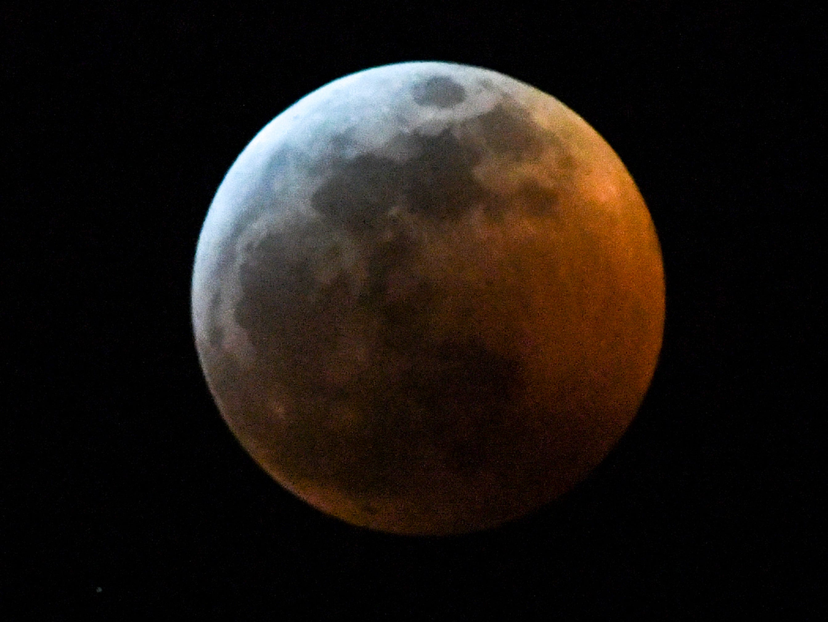 The Super blood wolf moon total lunar eclipse, at 11:50 p.m. (EST) January 20, 2019, shortly after when the moon edged into Earth's shadow and became darkened at 11:41 p.m., seen from Anderson, S.C.