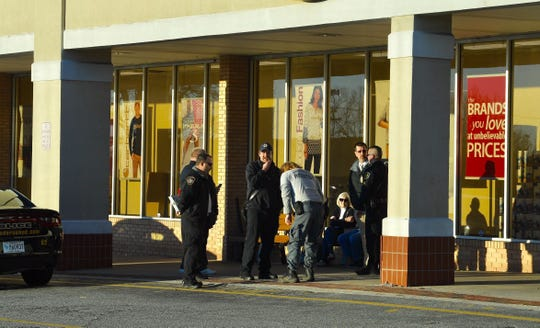 Anderson police outside the Hamrick's department store on North Main Street.