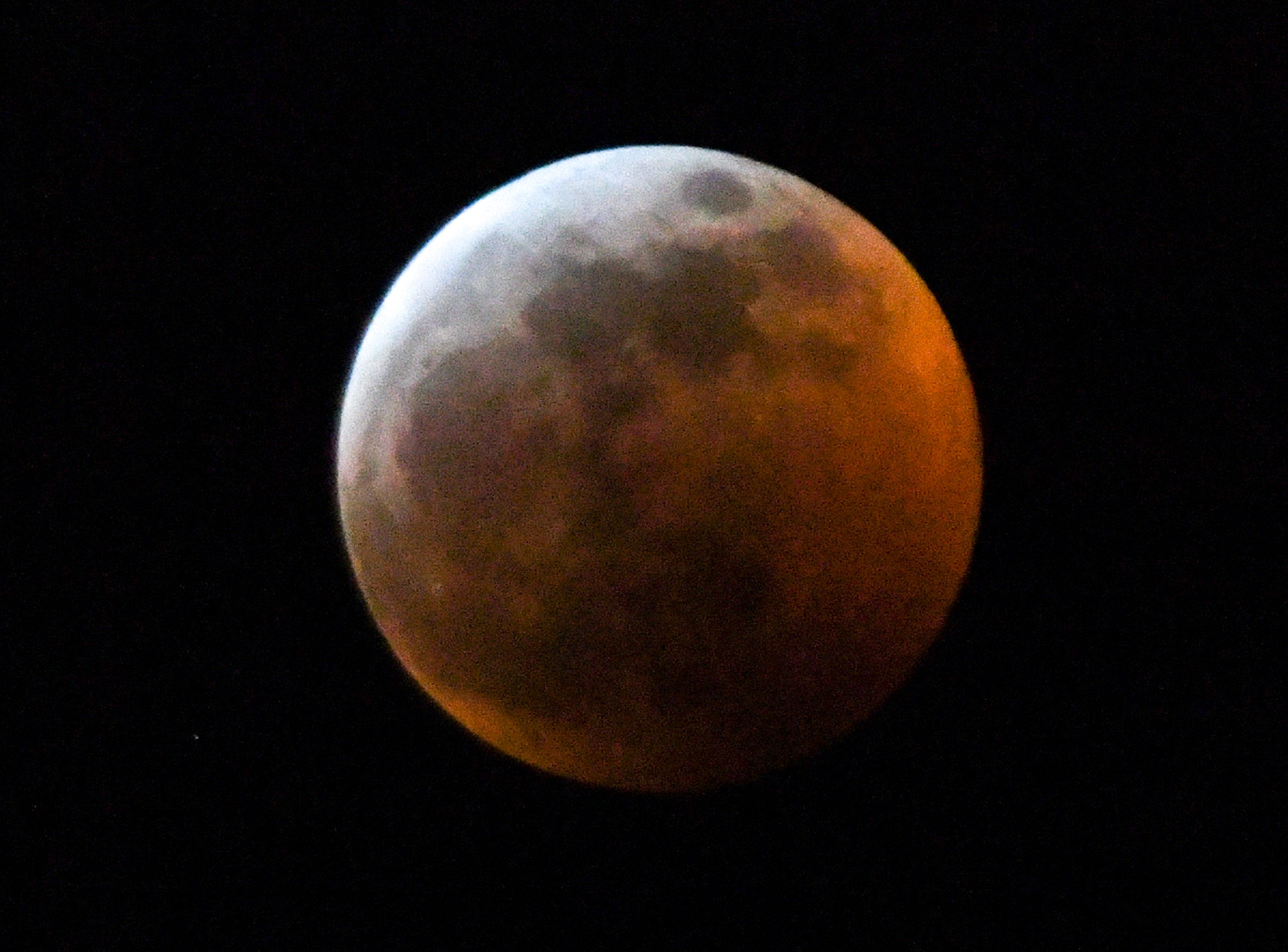 The Super blood wolf moon total lunar eclipse, at 11:58 p.m. (EST) January 20, 2019, shortly after when the moon edged into Earth's shadow and became darkened at 11:41 p.m., seen from Anderson, S.C.