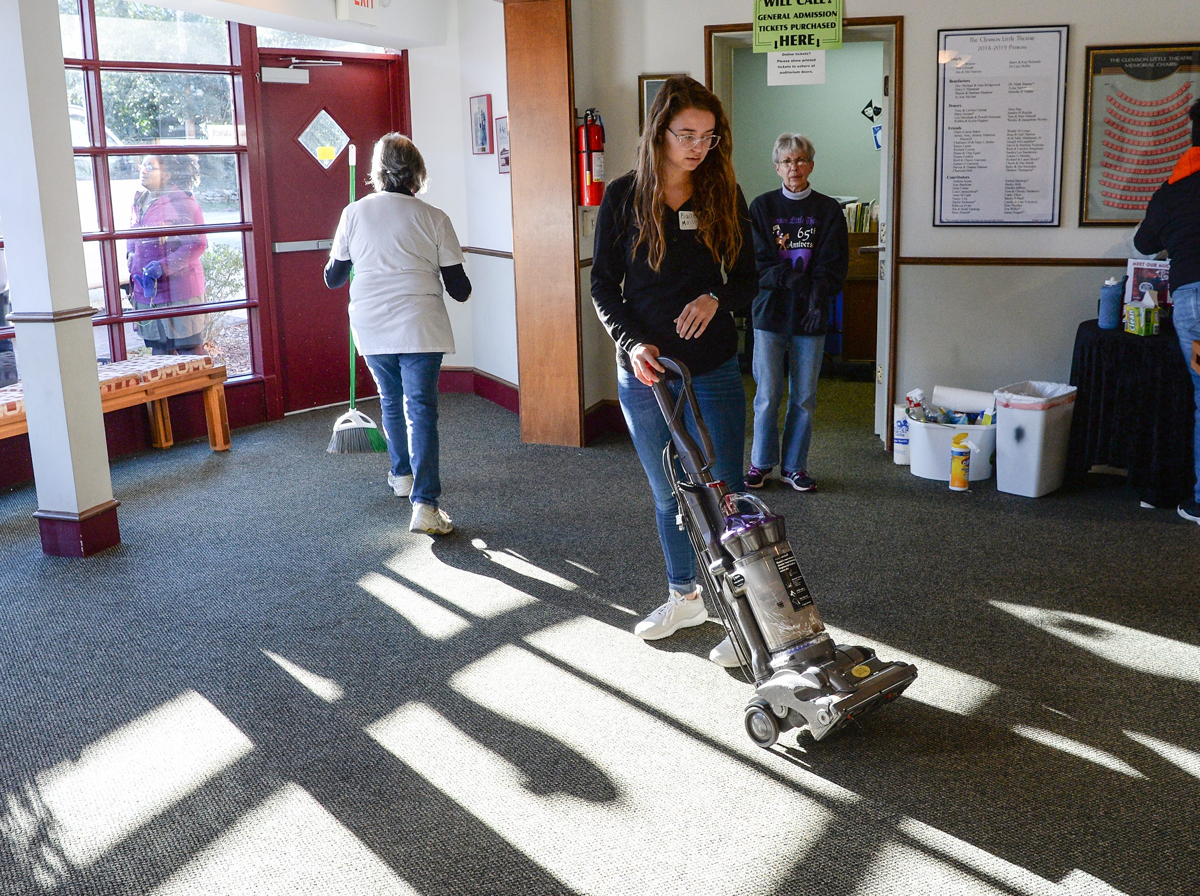 Bailey Massey, with Clemson University Gospel Choir members, helps clean the lobby at Clemson Little Theatre during the Clemson University Martin Luther King, Jr. Service Day in Clemson January 21, 2019.