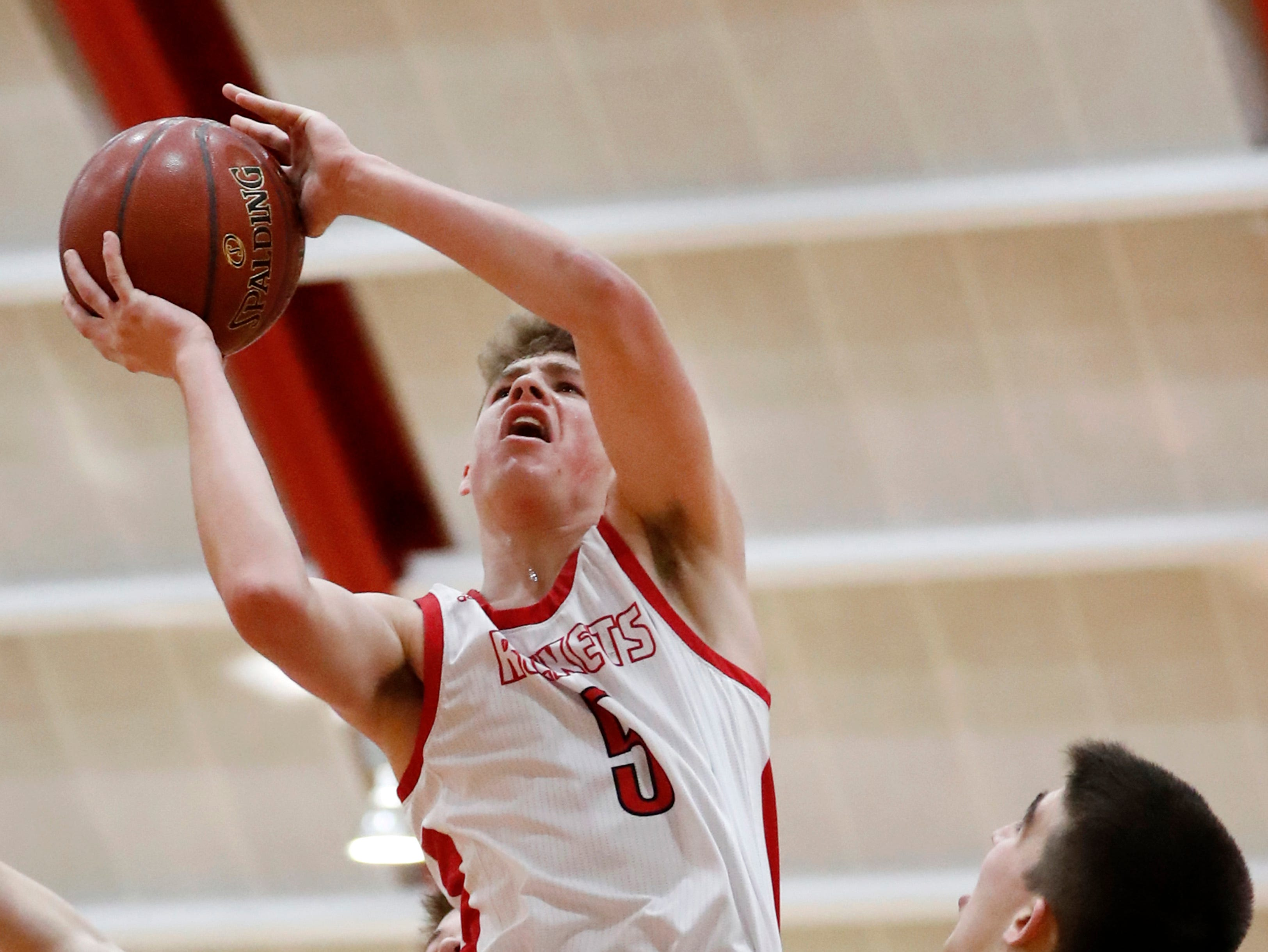 Neenah High SchoolÕs Max Klesmit jumps to the basket against Oshkosh North High School Friday, Jan. 18, 2019, in Neenah, Wis.