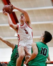 Neenah's Max Klesmit soars to the basket against Oshkosh North during a Fox Valley Association game in January.