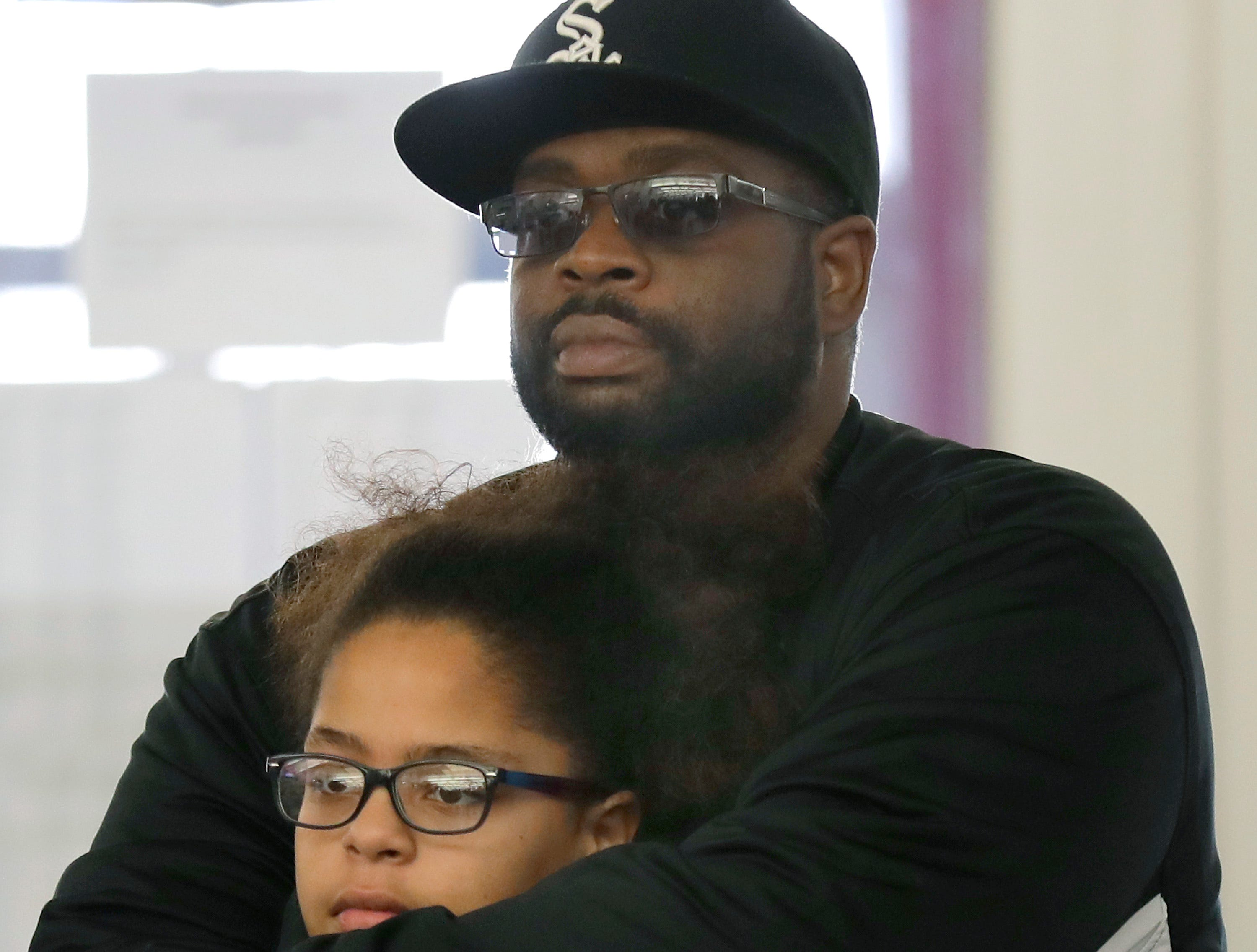 Montell Right holds his daughter Nivea Bushar while watching a performance during the first annual MLK Community Day of Service celebration on Monday, January 21, 2019, at Appleton East High School in Appleton, Wis.