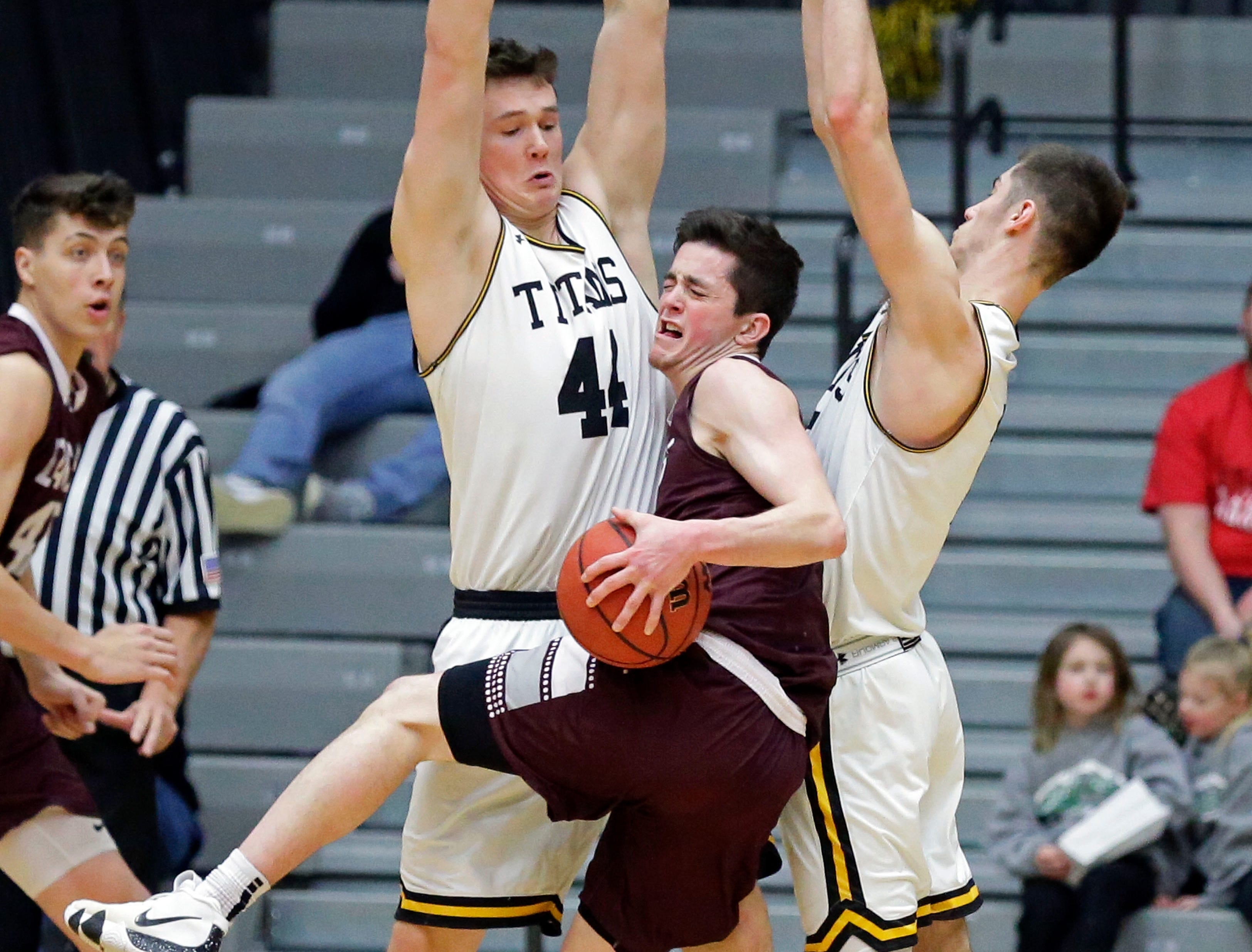 Brendon Manning of UW-La Crosse is pinned between Jack Flynn, left, and Adam Fravert of UW-Oshkosh in Wisconsin Intercollegiate Athletic Conference basketball Saturday, January 19, 2019, at Kolf Sports Center in Oshkosh, Wis. 