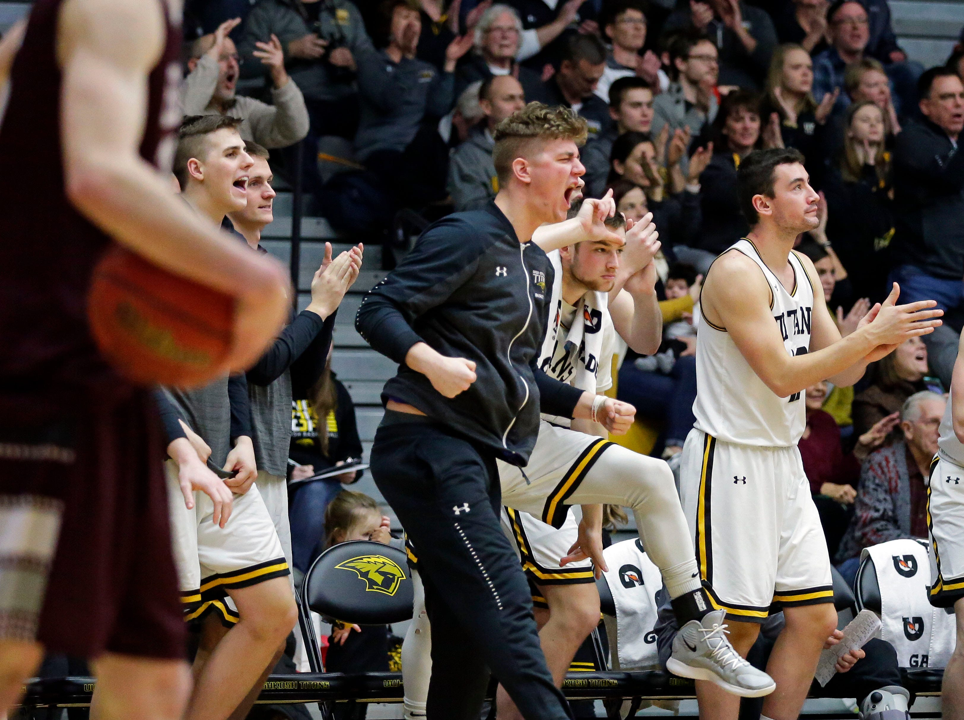 UW-Oshkosh players celebrate a play in the final minutes against UW-La Crosse in Wisconsin Intercollegiate Athletic Conference basketball Saturday, January 19, 2019, at Kolf Sports Center in Oshkosh, Wis. 
