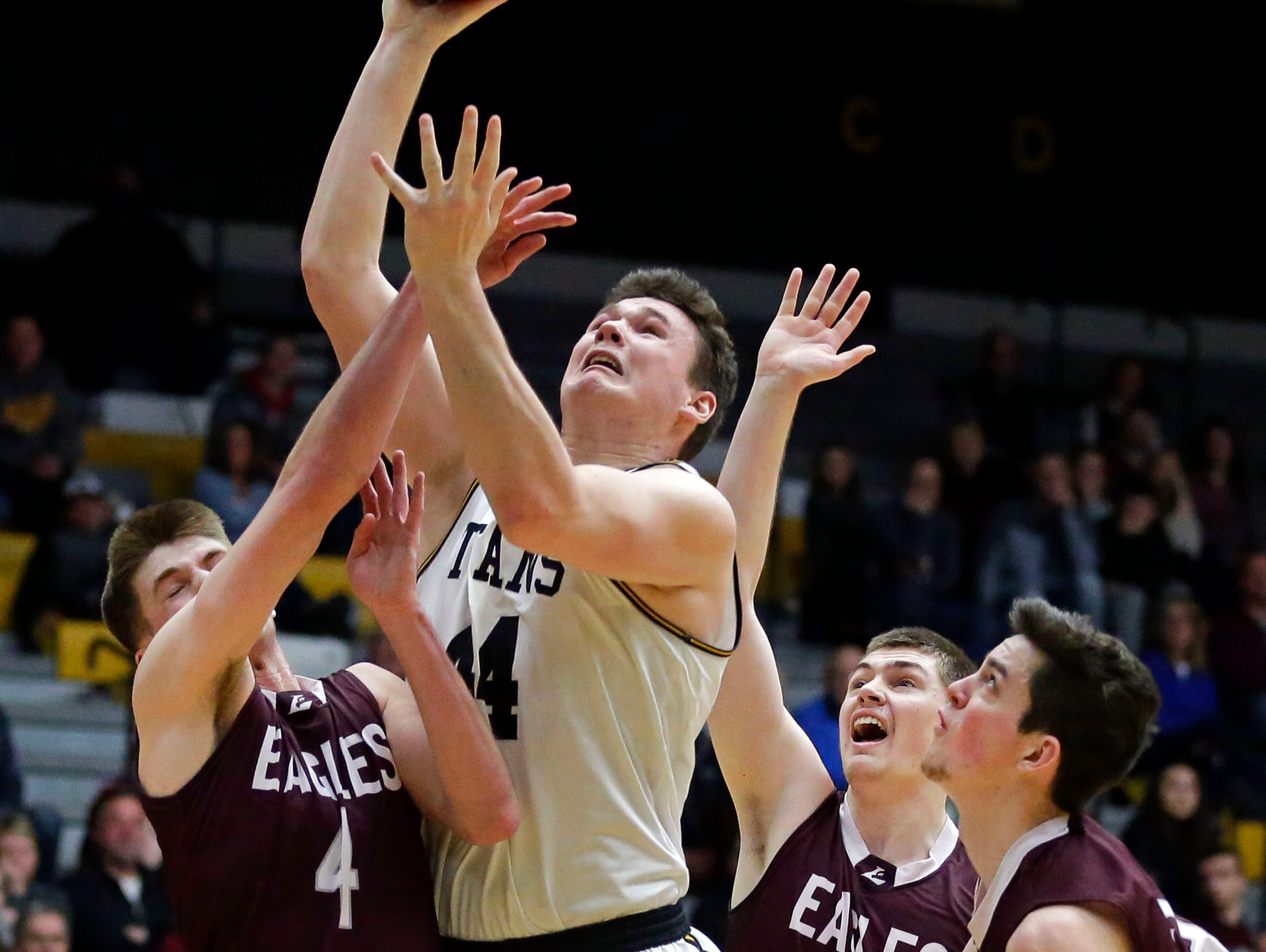 Jack Flynn of UW-Oshkosh goes up for a shot over Ethan Anderson, left, Wyatt Cook, center, and Brendon Manning of UW-La Crosse in Wisconsin Intercollegiate Athletic Conference basketball Saturday, January 19, 2019, at Kolf Sports Center in Oshkosh, Wis. 