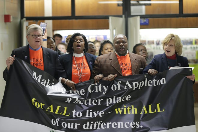 Appleton Mayor Tim Hanna, Diversity Coordinator Karen Nelson, Family First Ministries Pastor Alvin Dupree and Superintendent Judy Baseman took part in a march celebration to celebrate the legacy of Martin Luther King Jr.