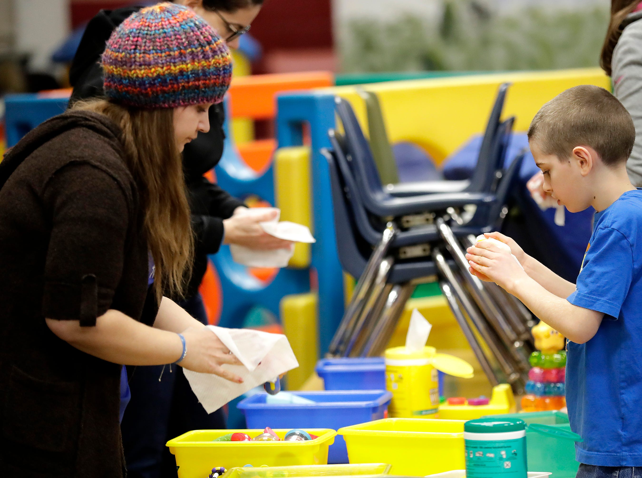 Amanda Hurray and Nolan Dassey volunteer for a shift of cleaning toys at B.A.B.E.S. Inc. Child Abuse Prevention Program during the first annual MLK Community Day of Service celebration on Monday, January 21, 2019, at Appleton East High School in Appleton, Wis.