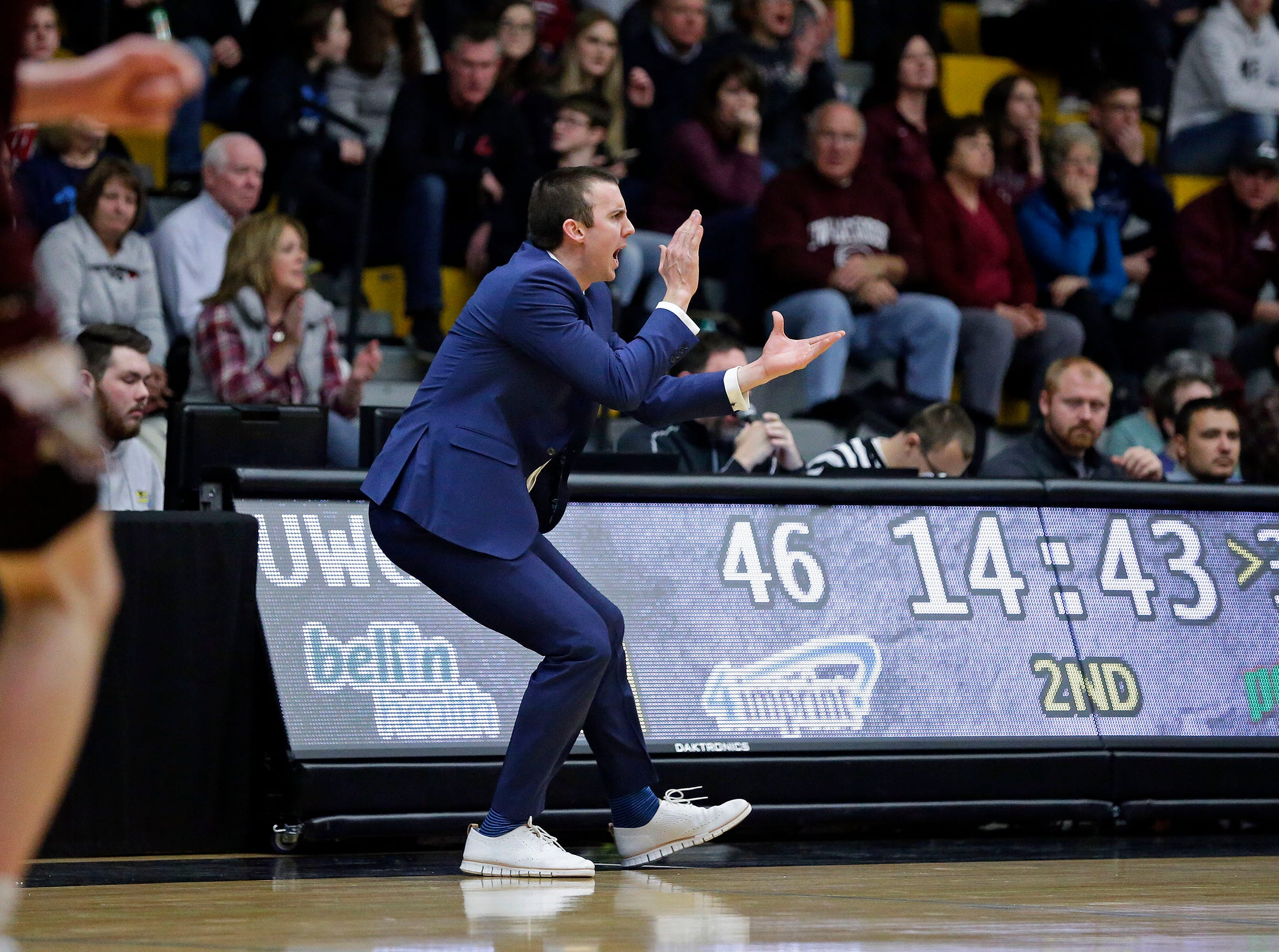 Interim head coach Matt Lewis of UW-Oshkosh talks to his team as they take on UW-La Crosse in Wisconsin Intercollegiate Athletic Conference basketball Saturday, January 19, 2019, at Kolf Sports Center in Oshkosh, Wis. 