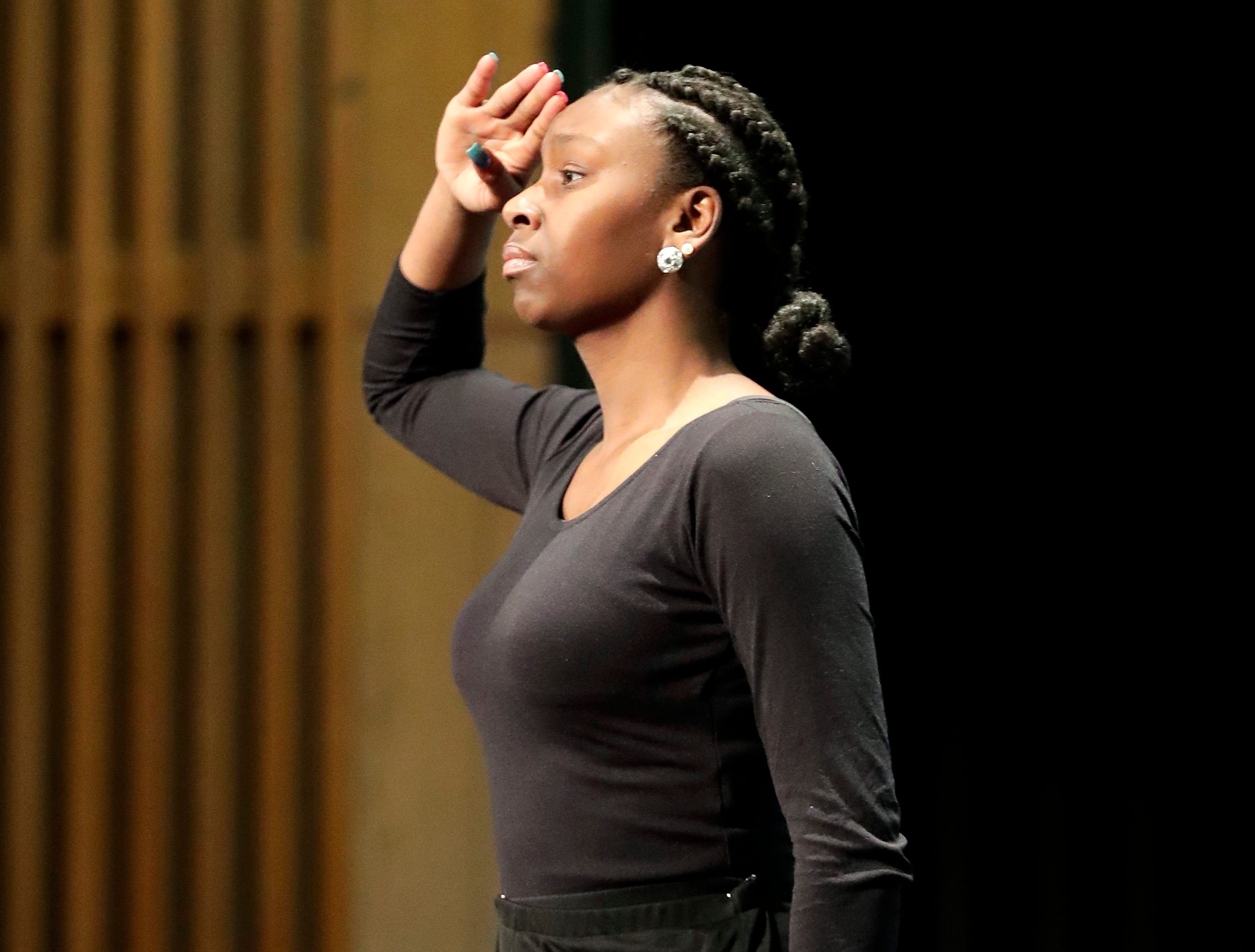"Destiny Daniels holds a pose at the end of her performance of ""War Cry"" during the first annual MLK Community Day of Service celebration on Monday, January 21, 2019, at Appleton East High School in Appleton, Wis.