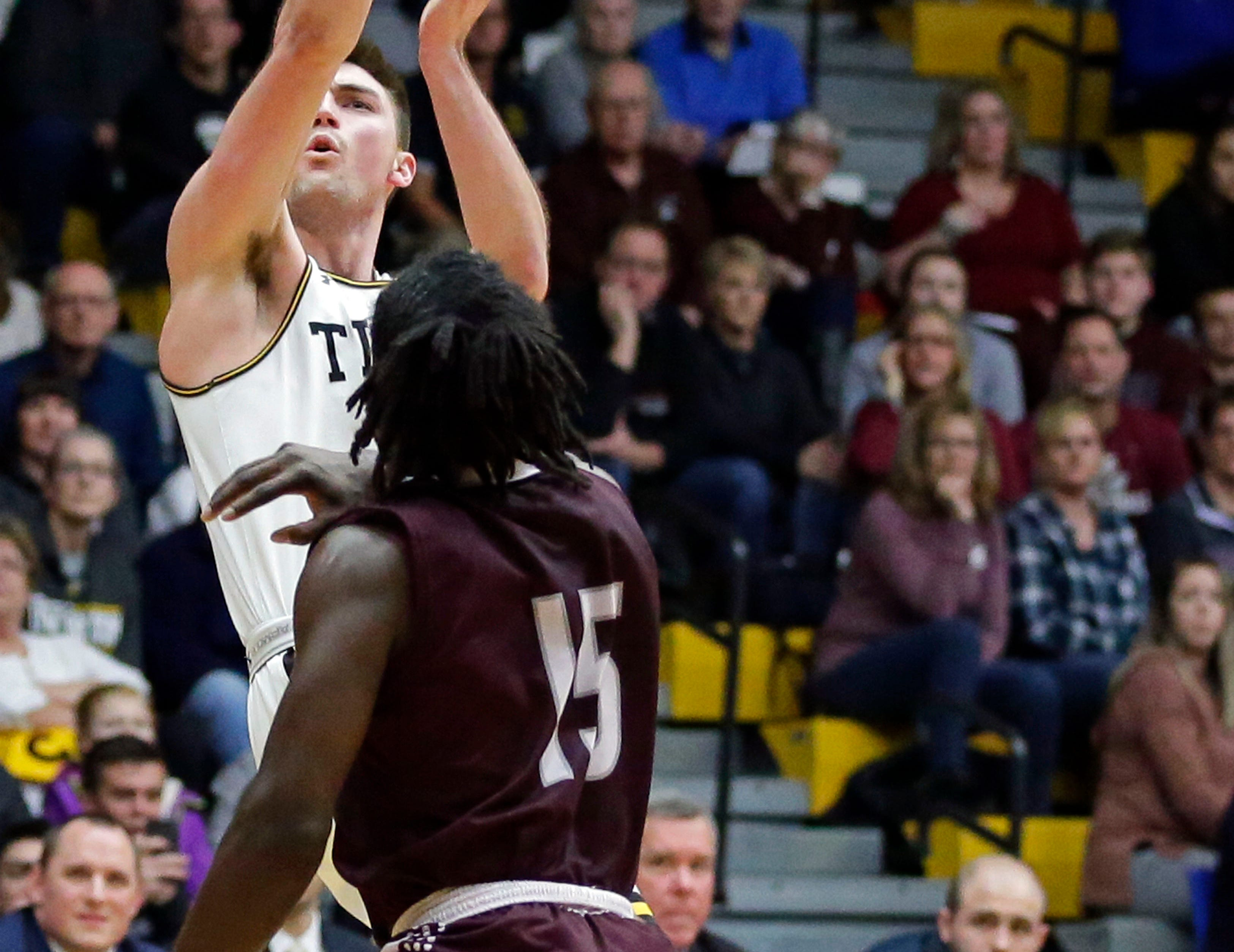 Brett Wittchow of UW-Oshkosh shoots over Taulvish McCray of UW-La Crosse in Wisconsin Intercollegiate Athletic Conference basketball Saturday, January 19, 2019, at Kolf Sports Center in Oshkosh, Wis. 