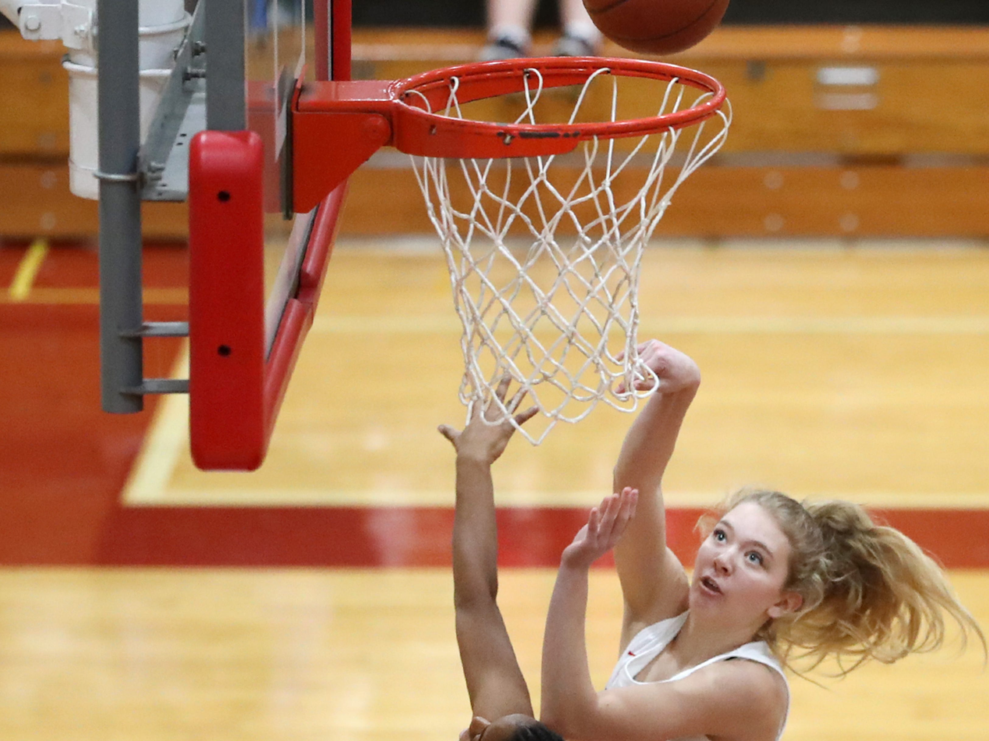Neenah High SchoolÕs Lexi Radies goes for a layup during their game against Oshkosh North High School Friday, Jan. 18, 2019, in Neenah, Wis.