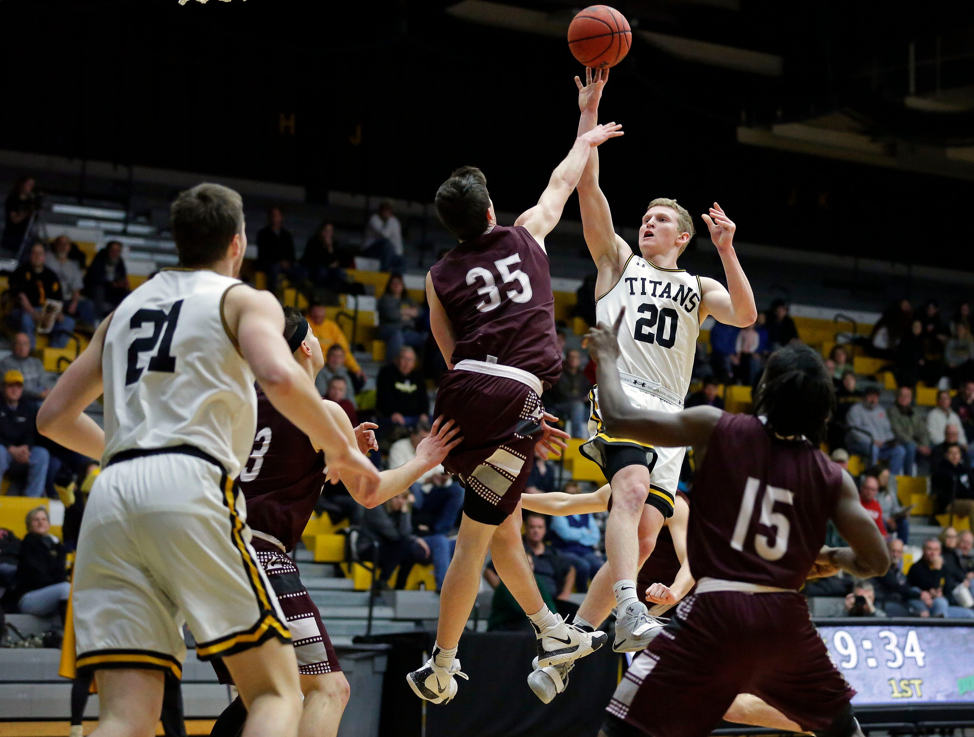 Brendon Manning of UW-La Crosse tries to defend a shot by Connor Duax of UW-Oshkosh in Wisconsin Intercollegiate Athletic Conference basketball Saturday, January 19, 2019, at Kolf Sports Center in Oshkosh, Wis. 